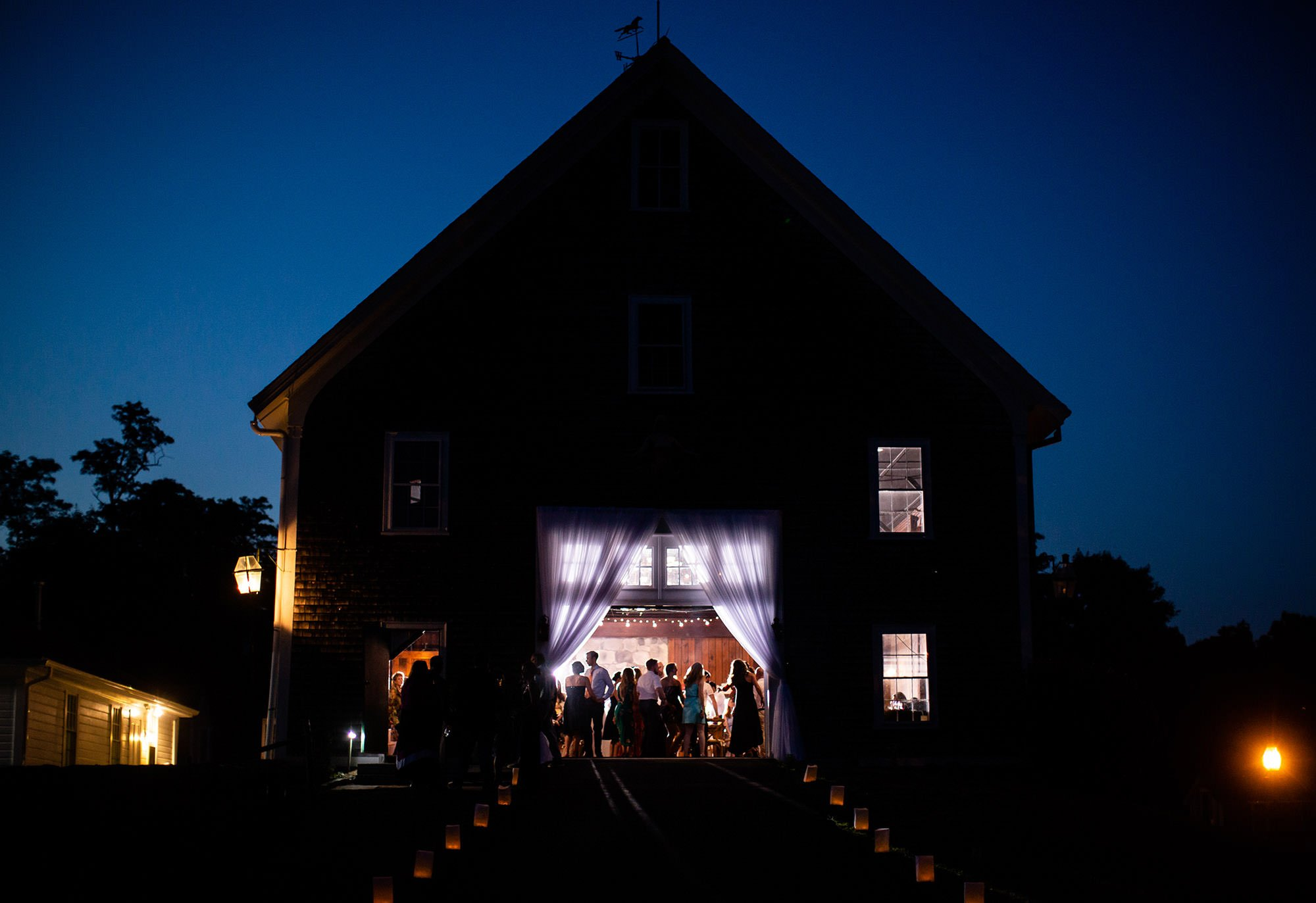 Sunset during the wedding reception at Mount Hope Farm's barn.