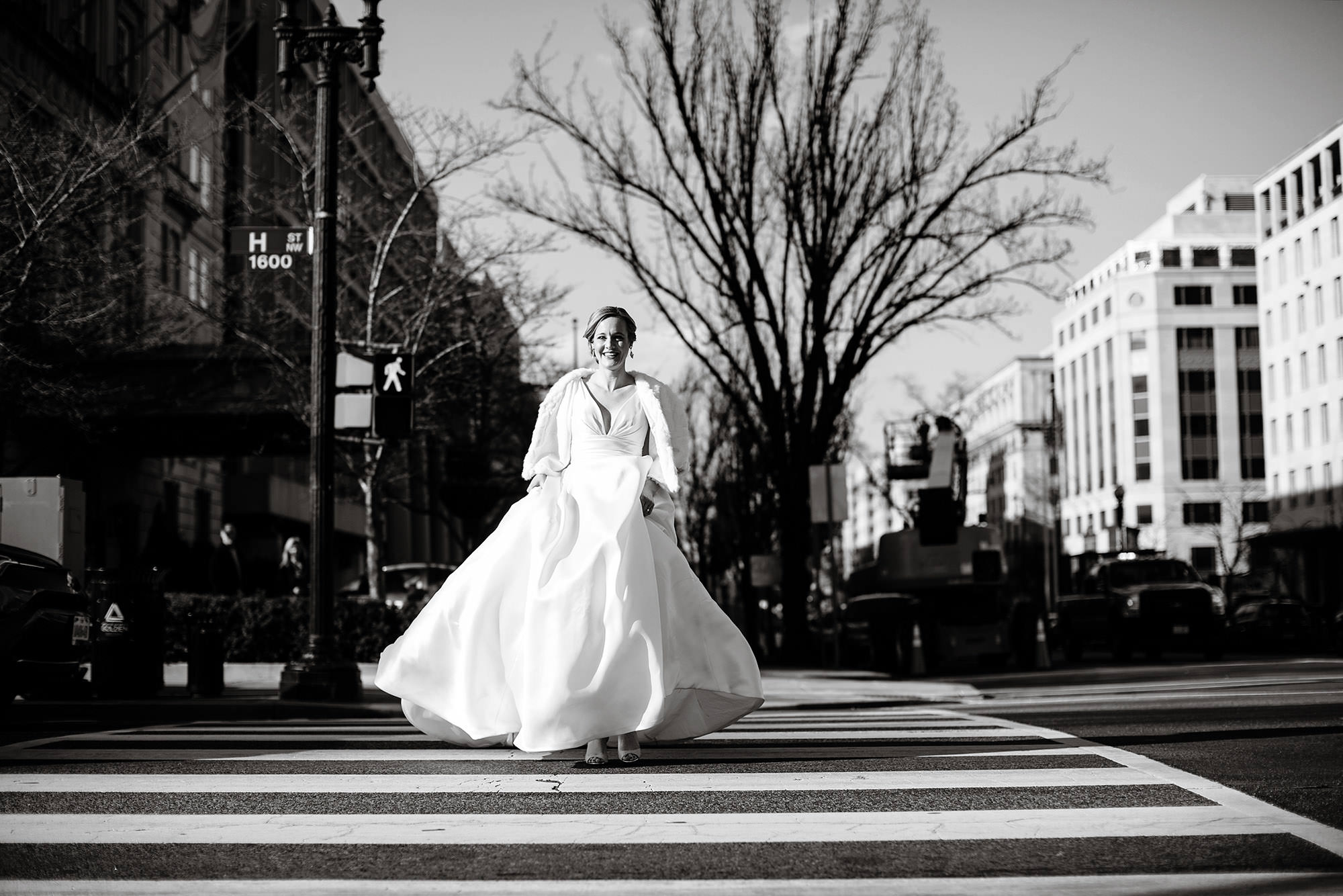 NMWA DC Wedding  I  The bride walks down a crosswalk before the first look at Lafayette Park in Washington, DC.