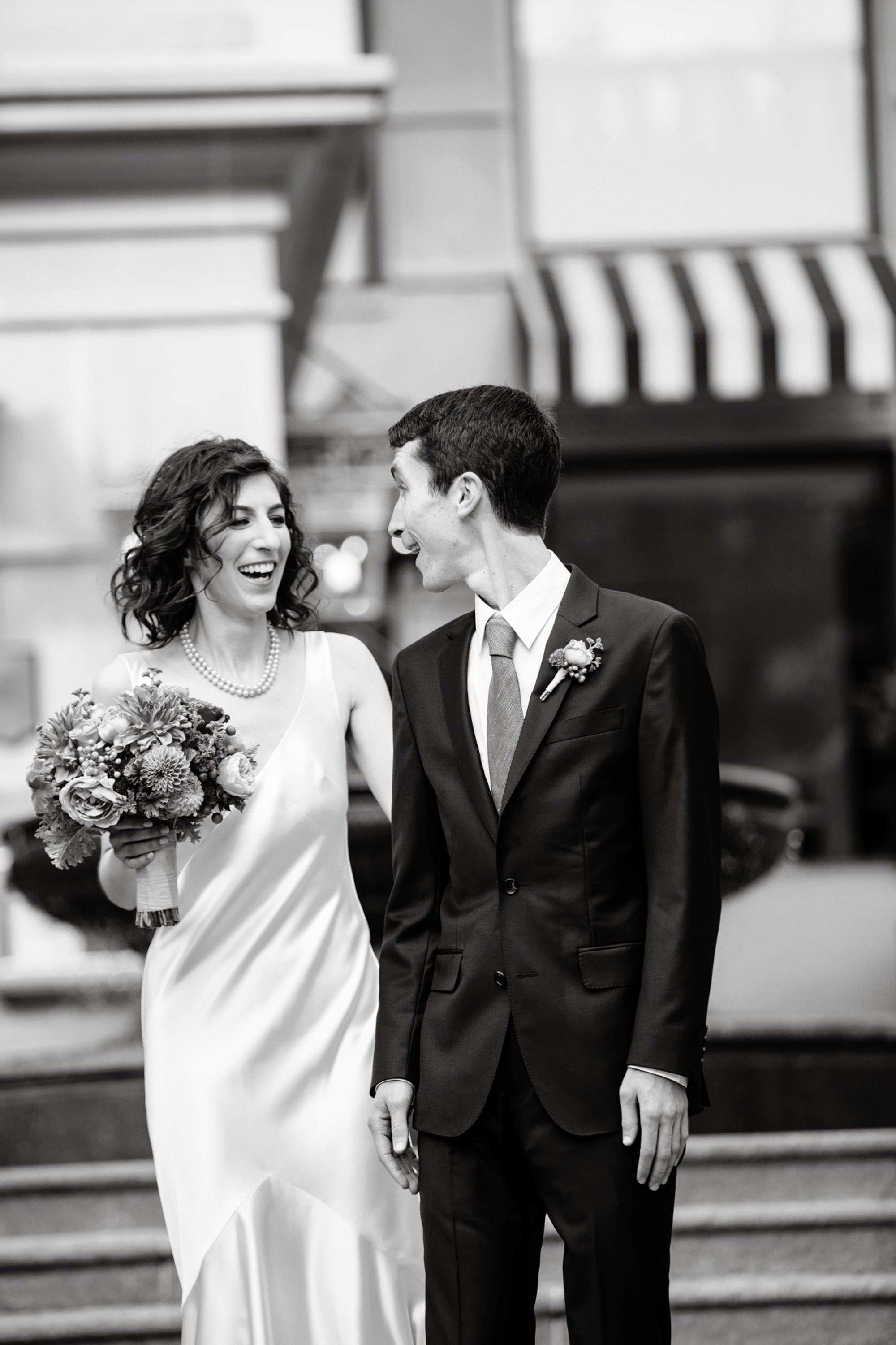 The bride and groom share their first look in front of the Willard InterContinental Hotel.