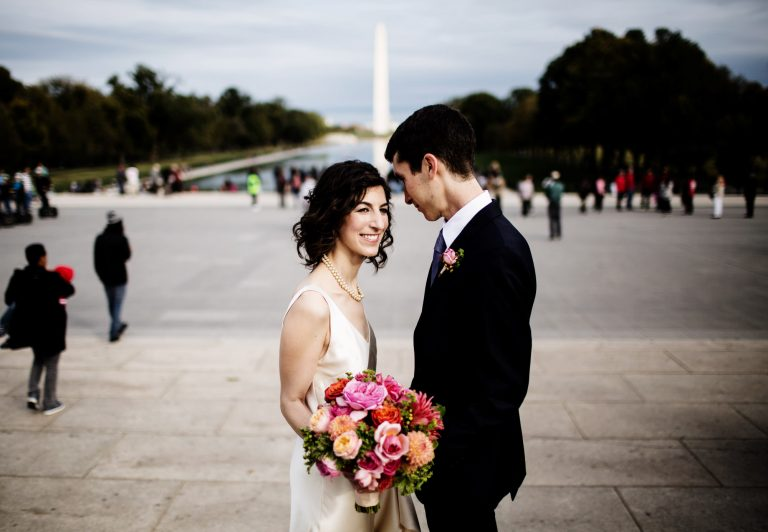 NMWA Wedding in Washington, DC I The bride and groom pose for a portrait on the National Mall.