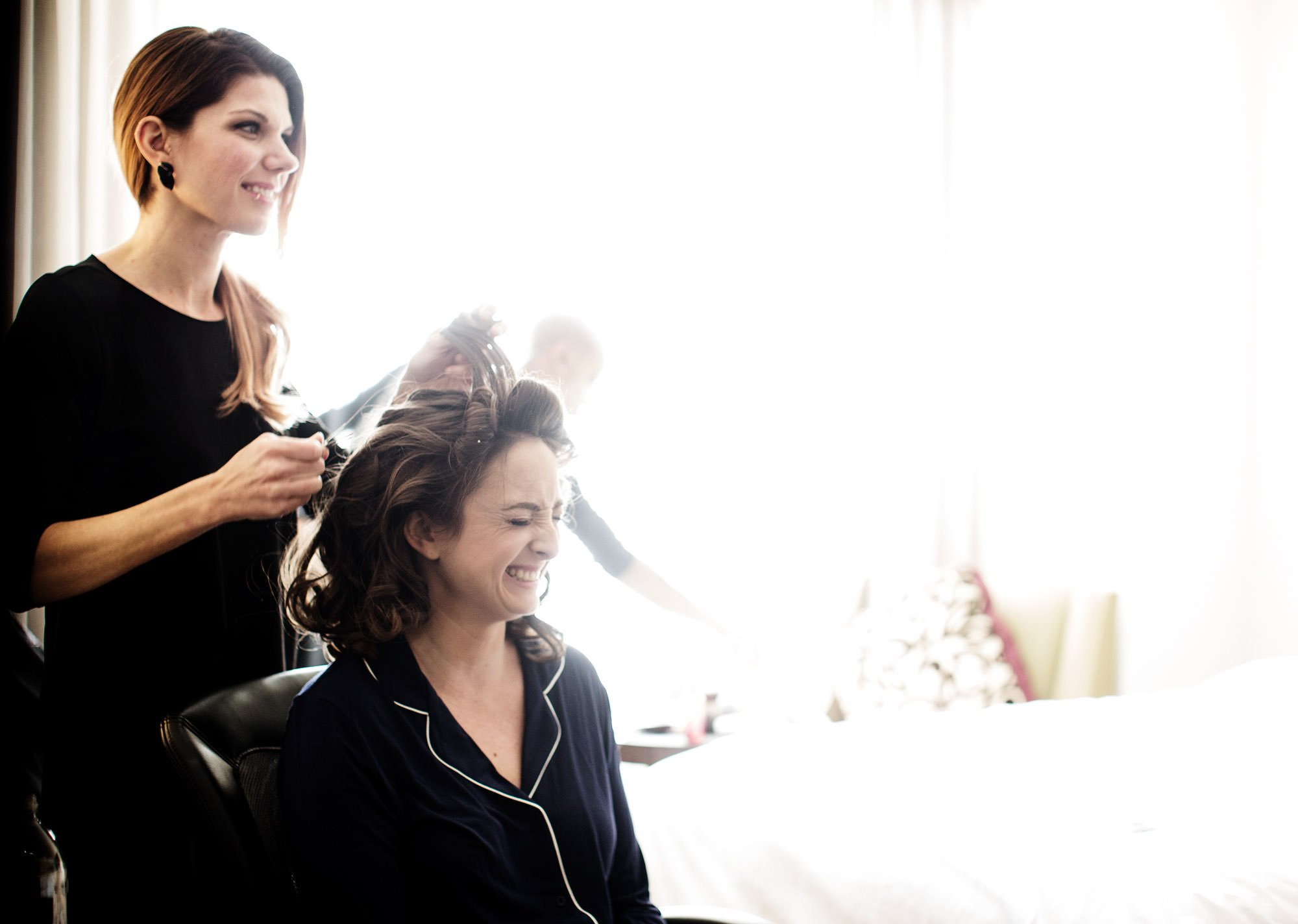 The bride gets her hair done before her NMWA wedding.