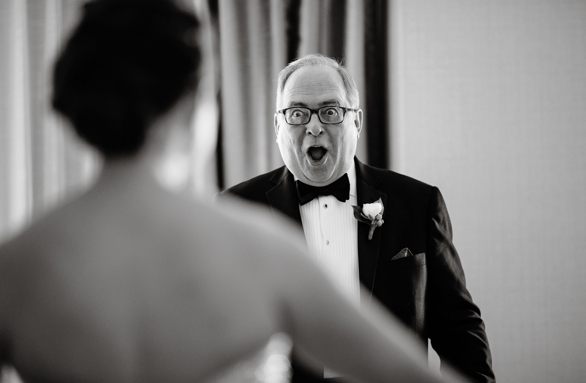 The Father of the Bride sees his daughter in her wedding dress before her NMWA wedding.