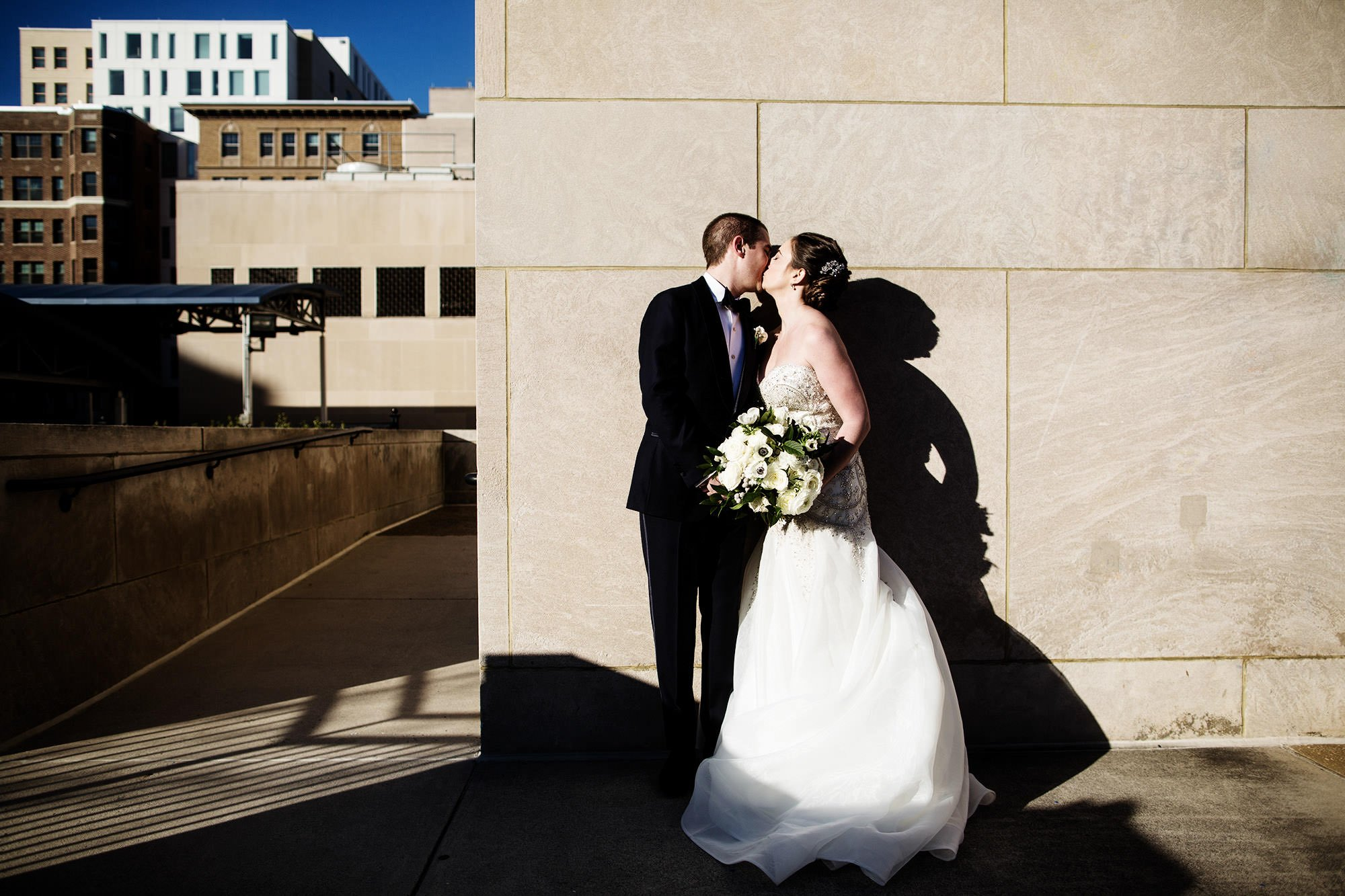 A portrait of the Bride and Groom at Kogan Plaza.