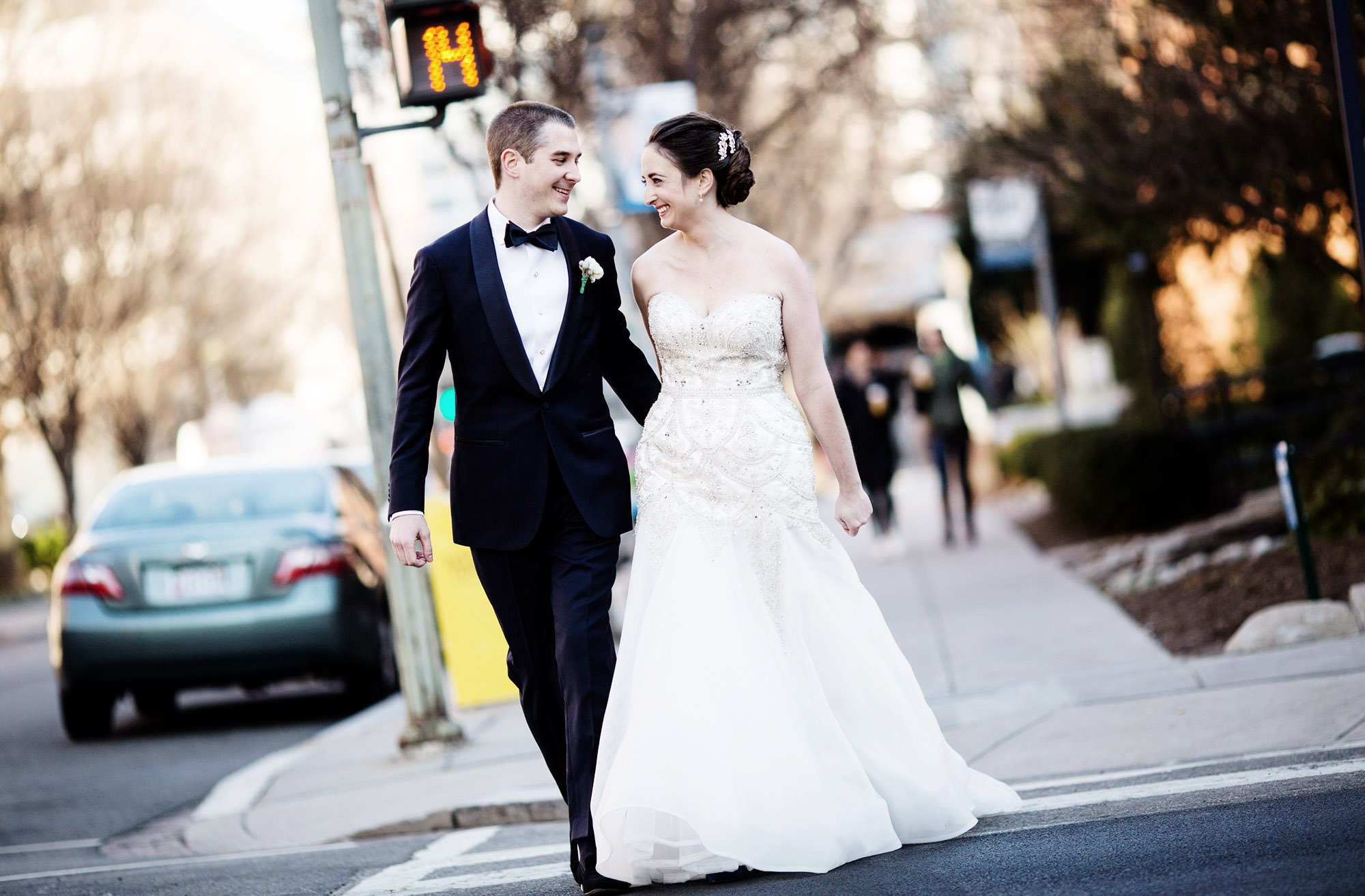 A portrait of the bride and groom as they cross the street before their NMWA wedding.