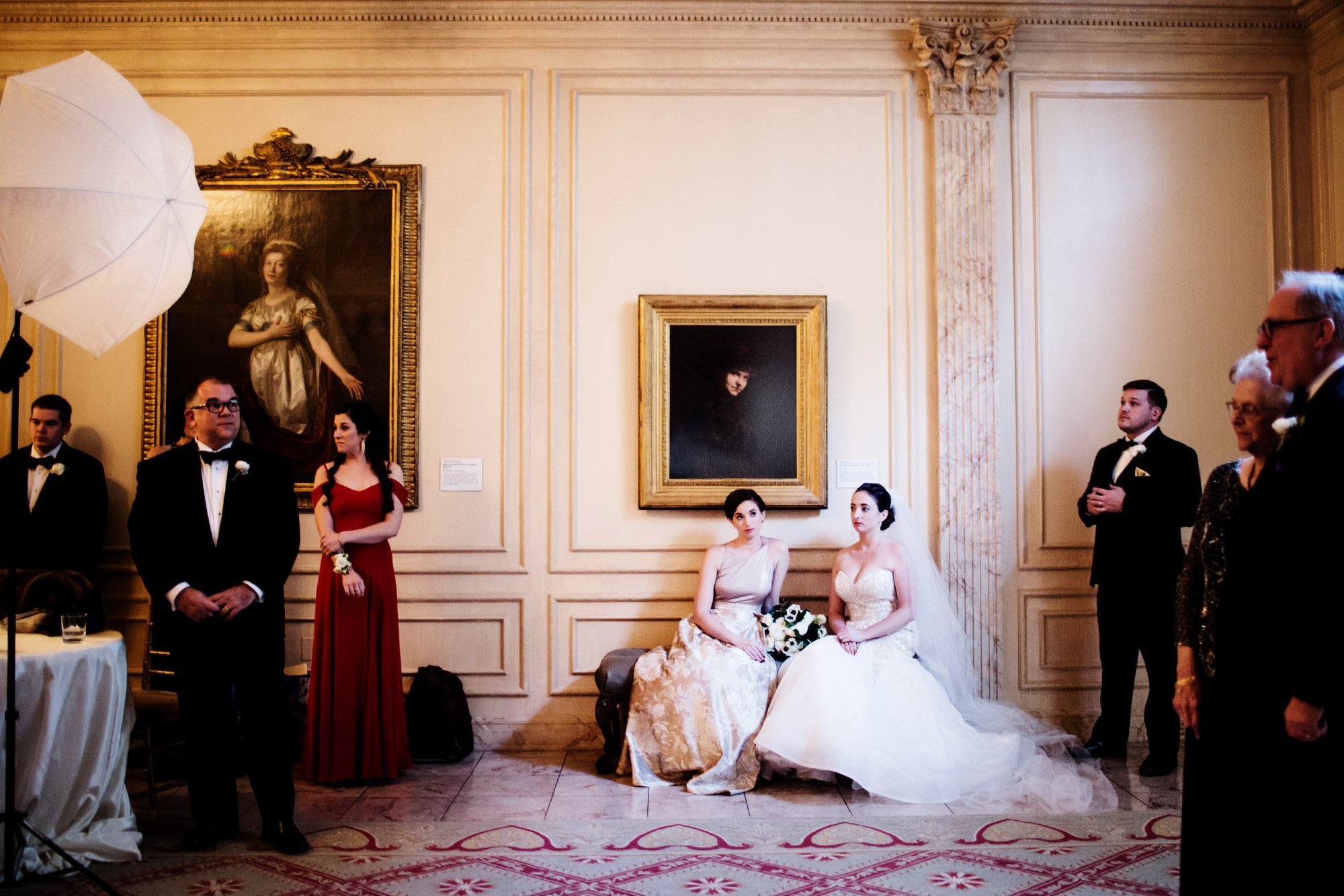 The Bride and Maid of Honor sit during the portrait period of this NMWA wedding.