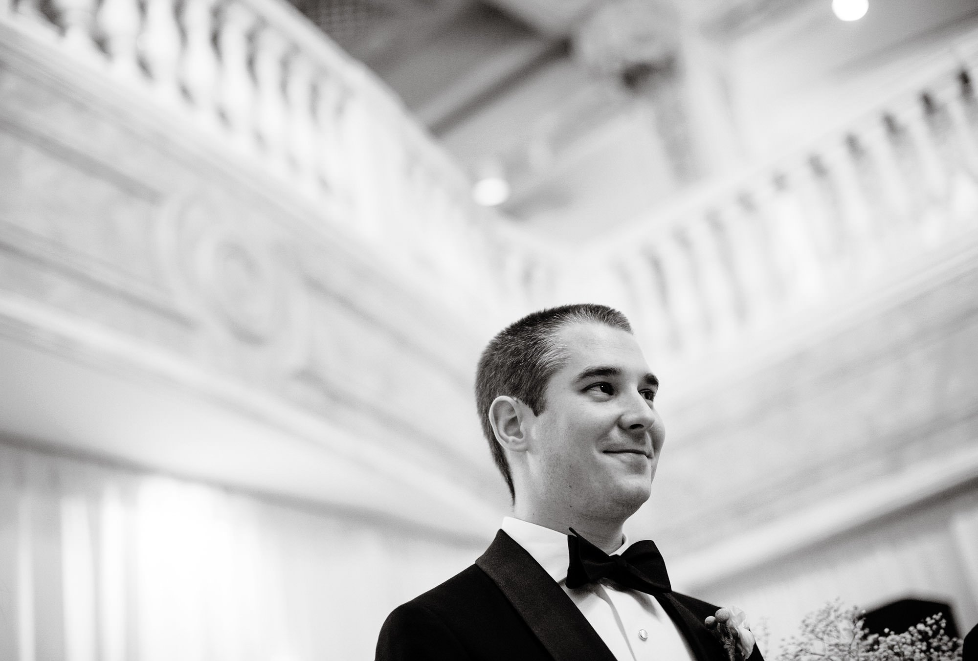 The groom watches as his bride walks down the aisle during the NMWA wedding ceremony.