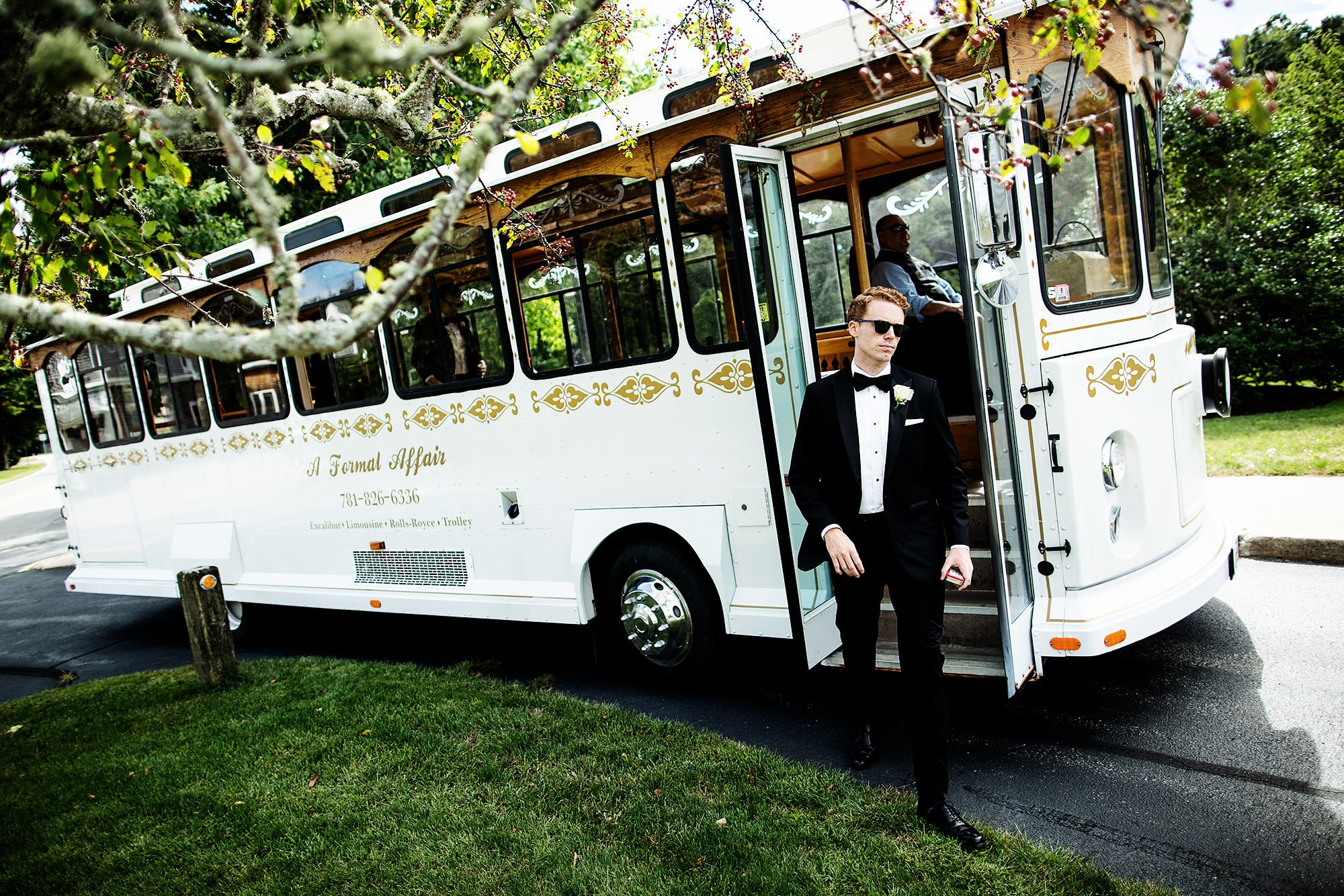 The groom steps off the trolley at Ocean Edge resort prior to the ceremony.