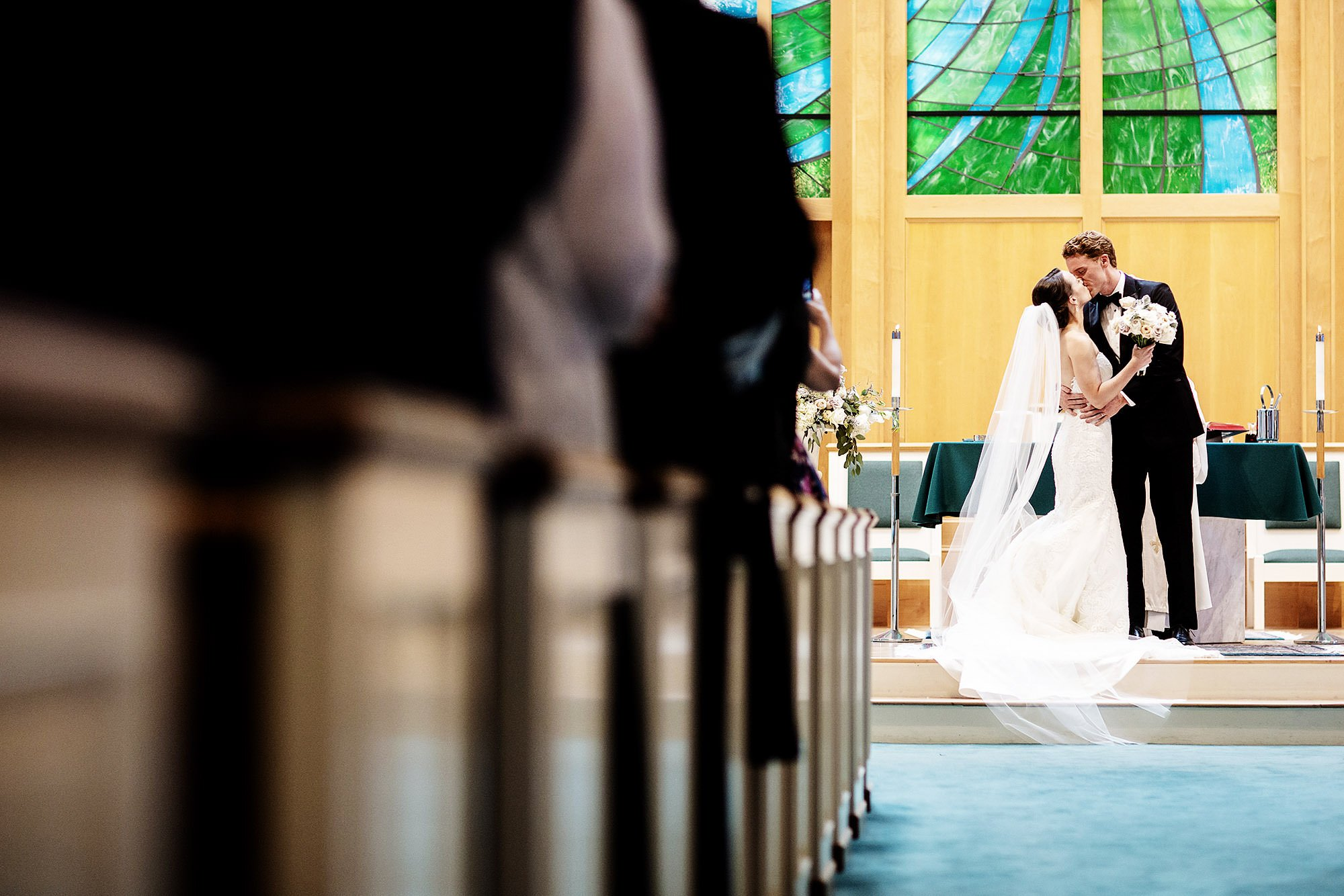 The bride and groom's First Kiss at St. Joan of Arc Church, Orleans, MA