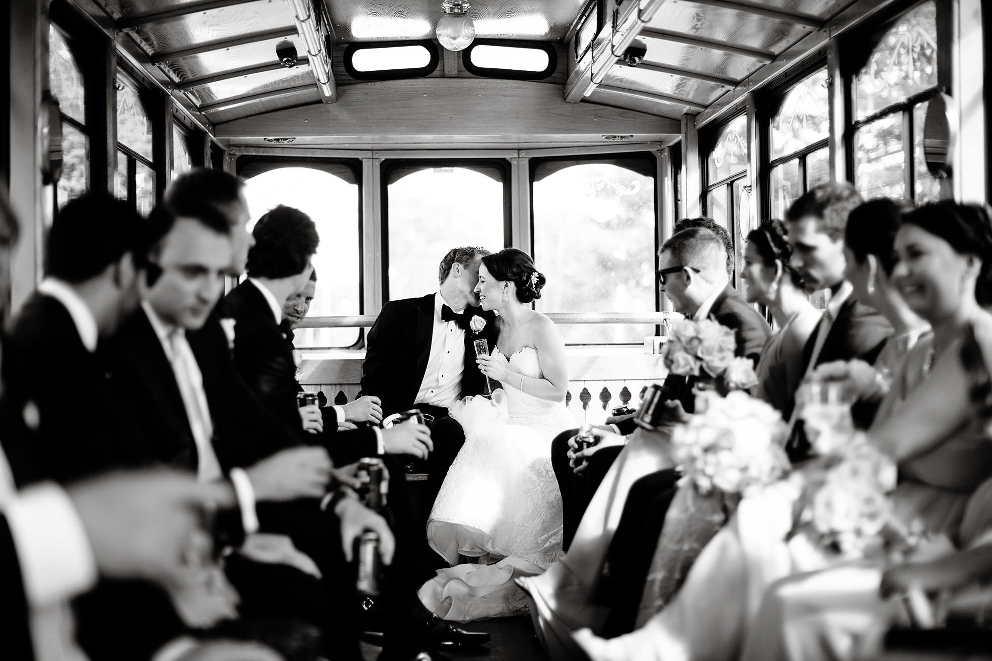 The bride and groom share an intimate moment on the trolley.