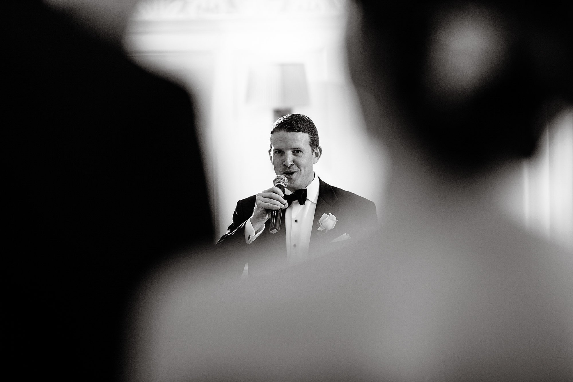 The best man gives a toast during the reception.