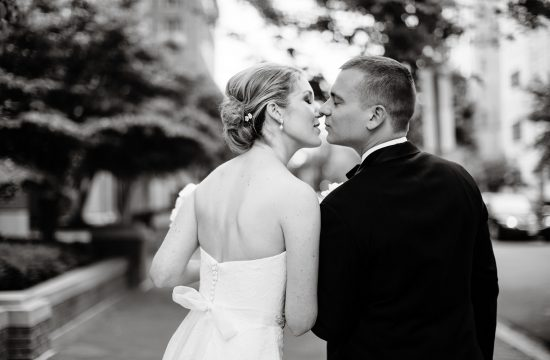 Park Hyatt DC Wedding I The bride and groom kiss while walking down the street in Washington, DC