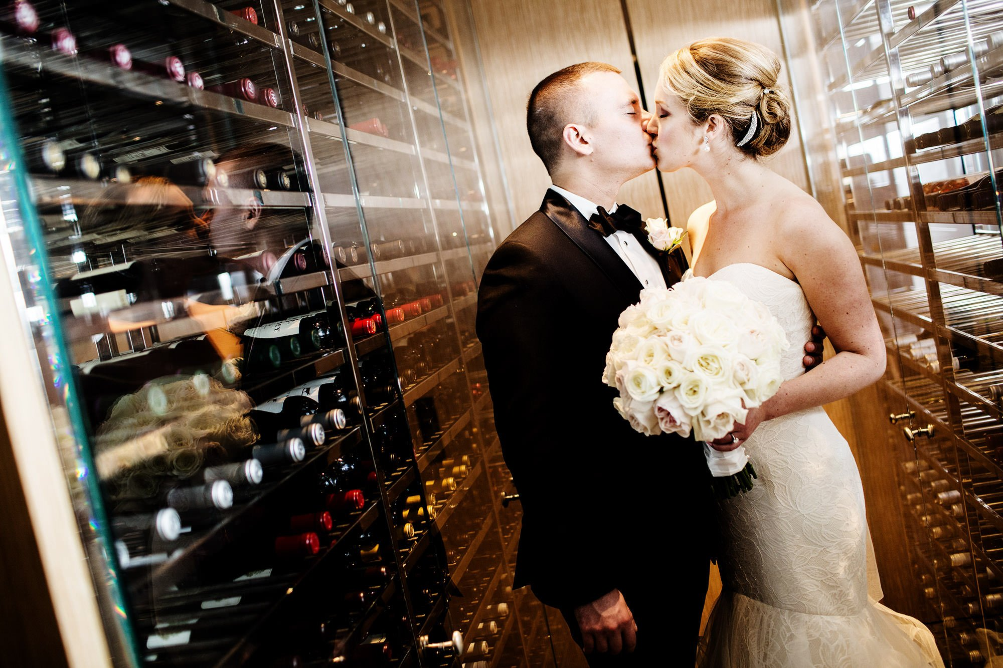 The Bride and Groom kiss in the Park Hyatt DC's wine racks