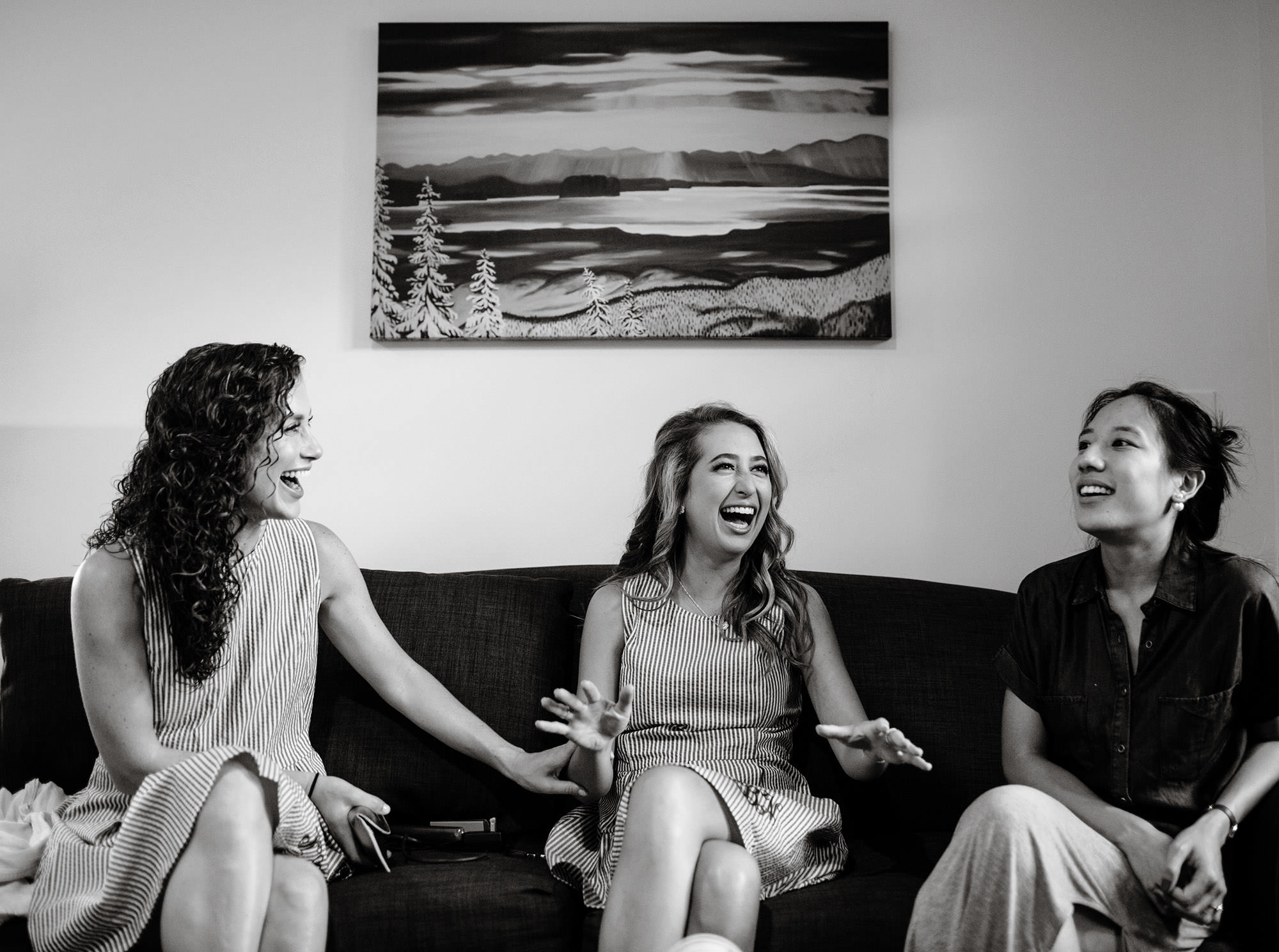 Bridesmaids laugh before the wedding ceremony.