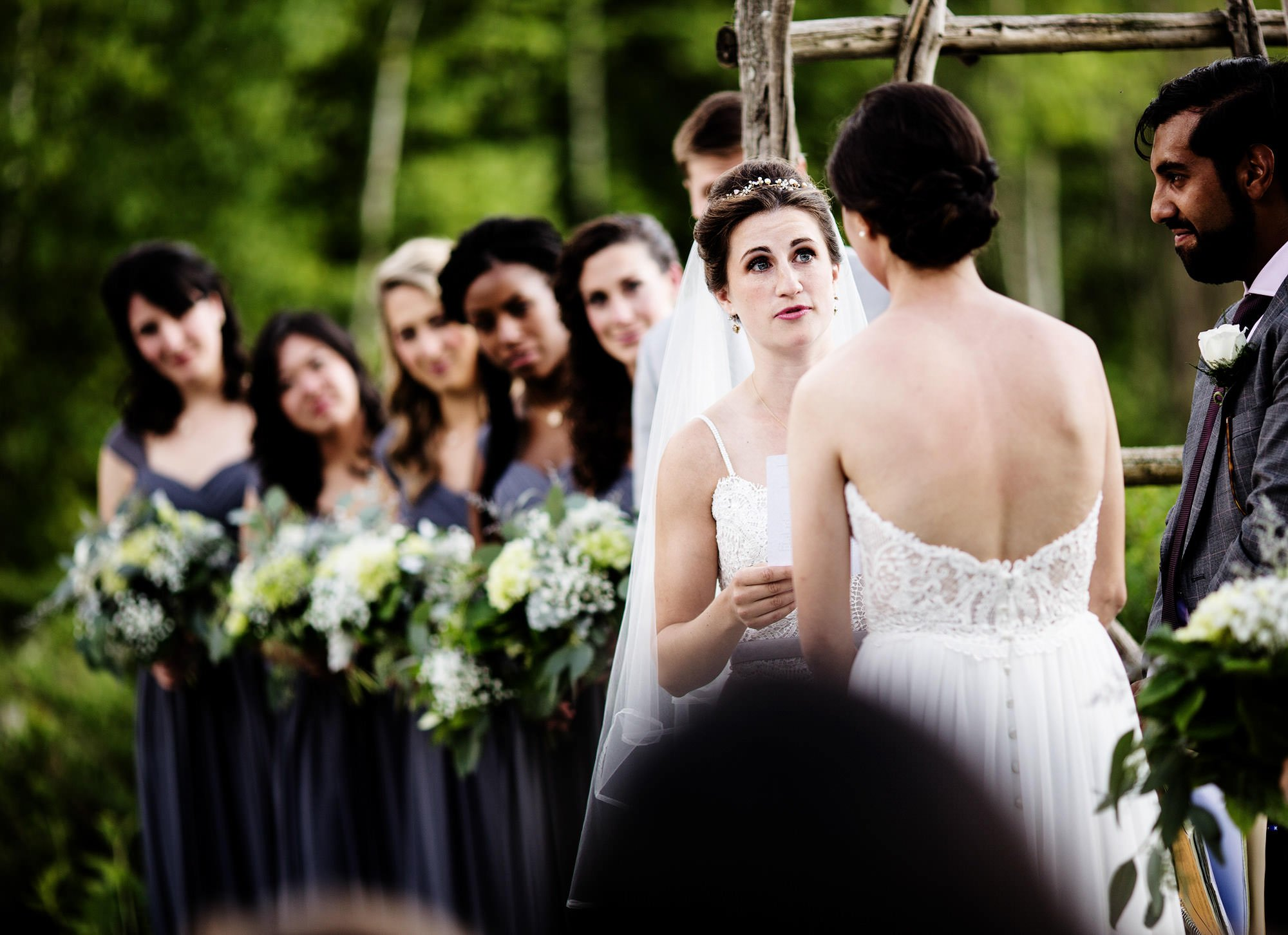 The brides exchange vows during the ceremony at The Ponds at Bolton Valley Wedding, Waterbury, VT
