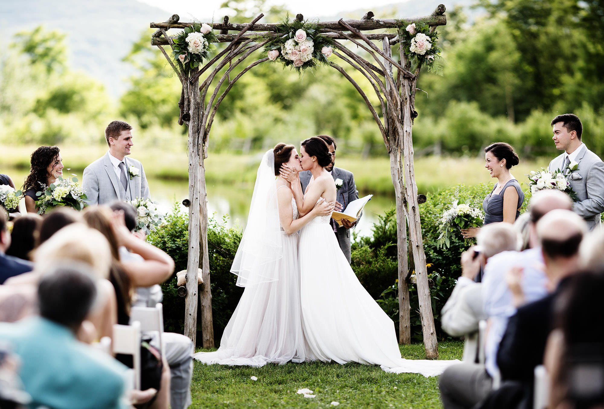 The brides share their first kiss.