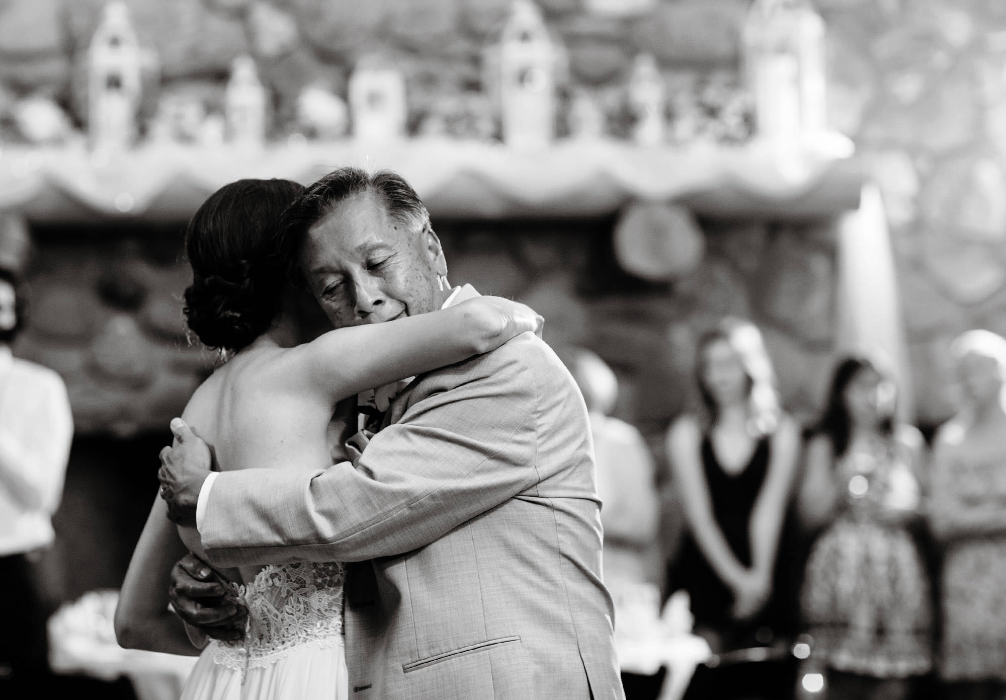 The bride dances with her father during the reception.