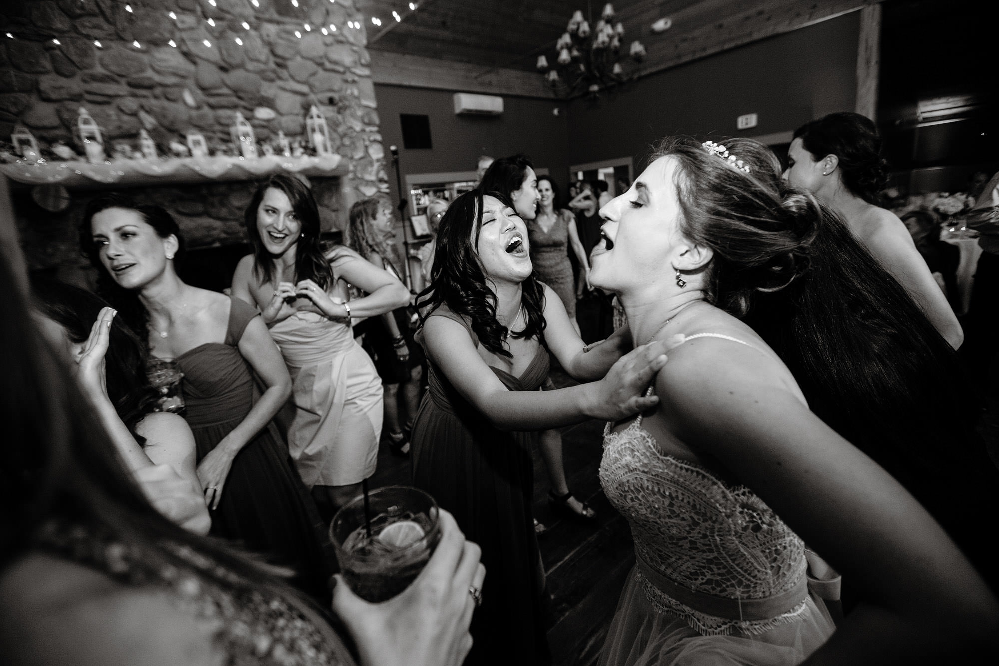Guests enjoy the wedding reception while dancing.