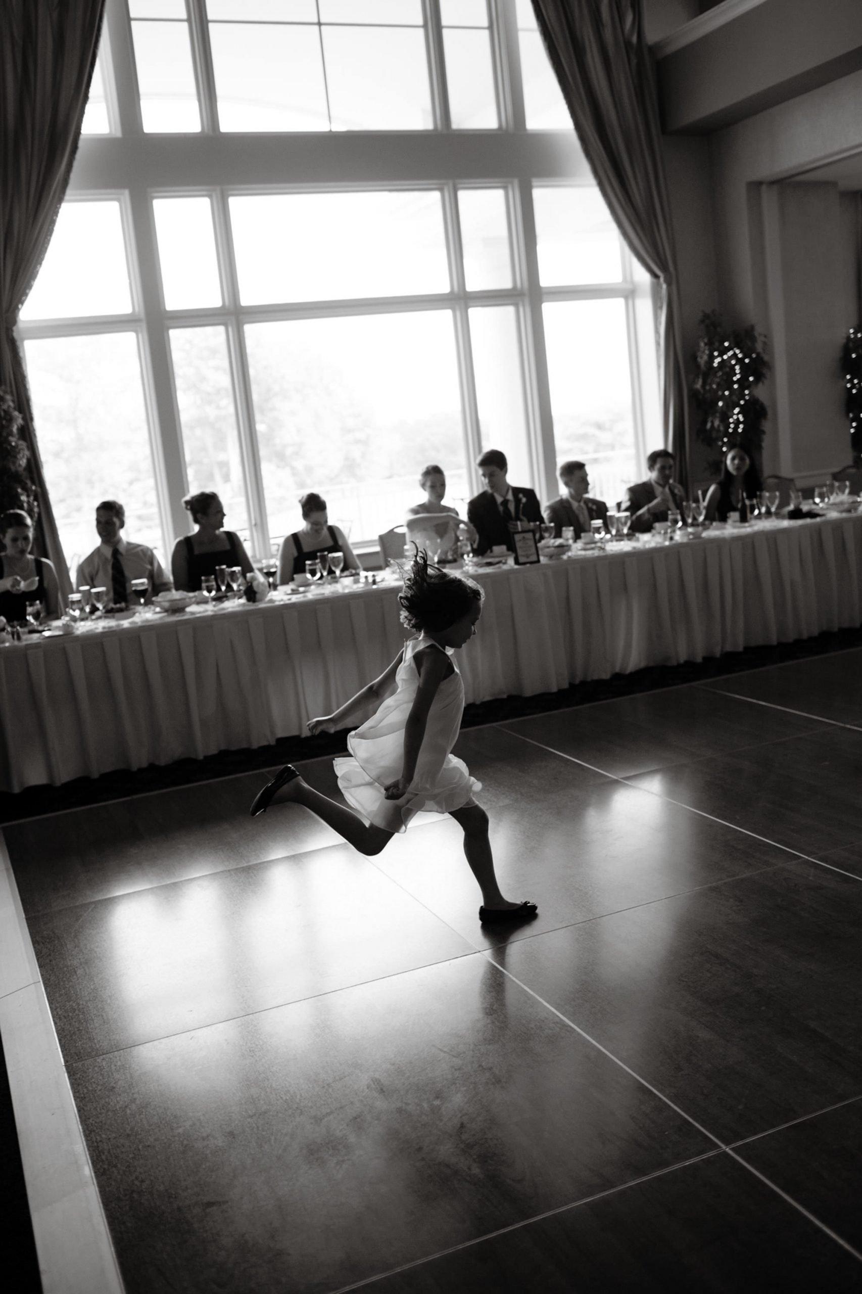 Springfield Golf and Country Club Wedding  I  A flower girl runs across the dance floor.