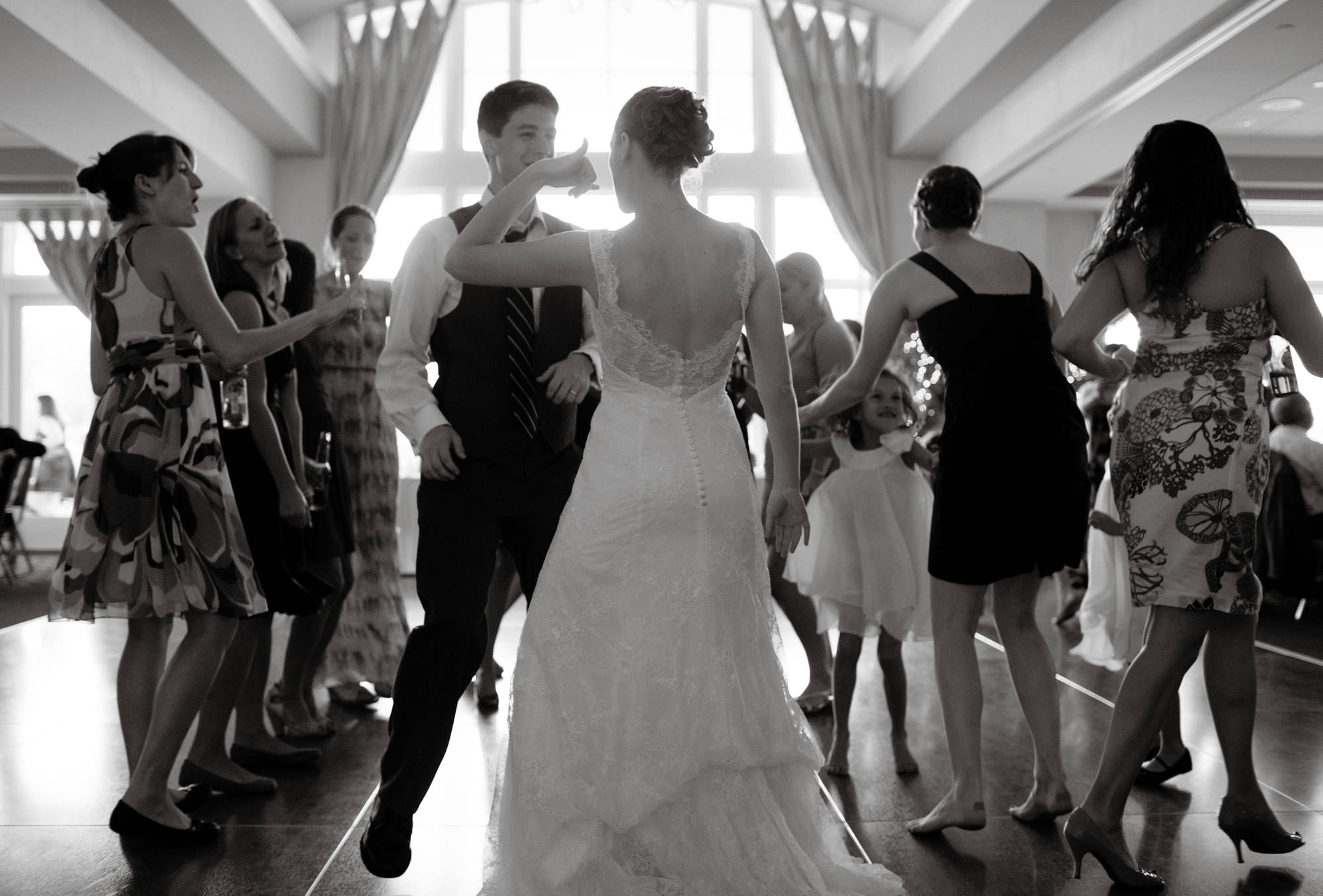 Springfield Golf and Country Club Wedding  I  The couple dance on a crowded dance floor.
