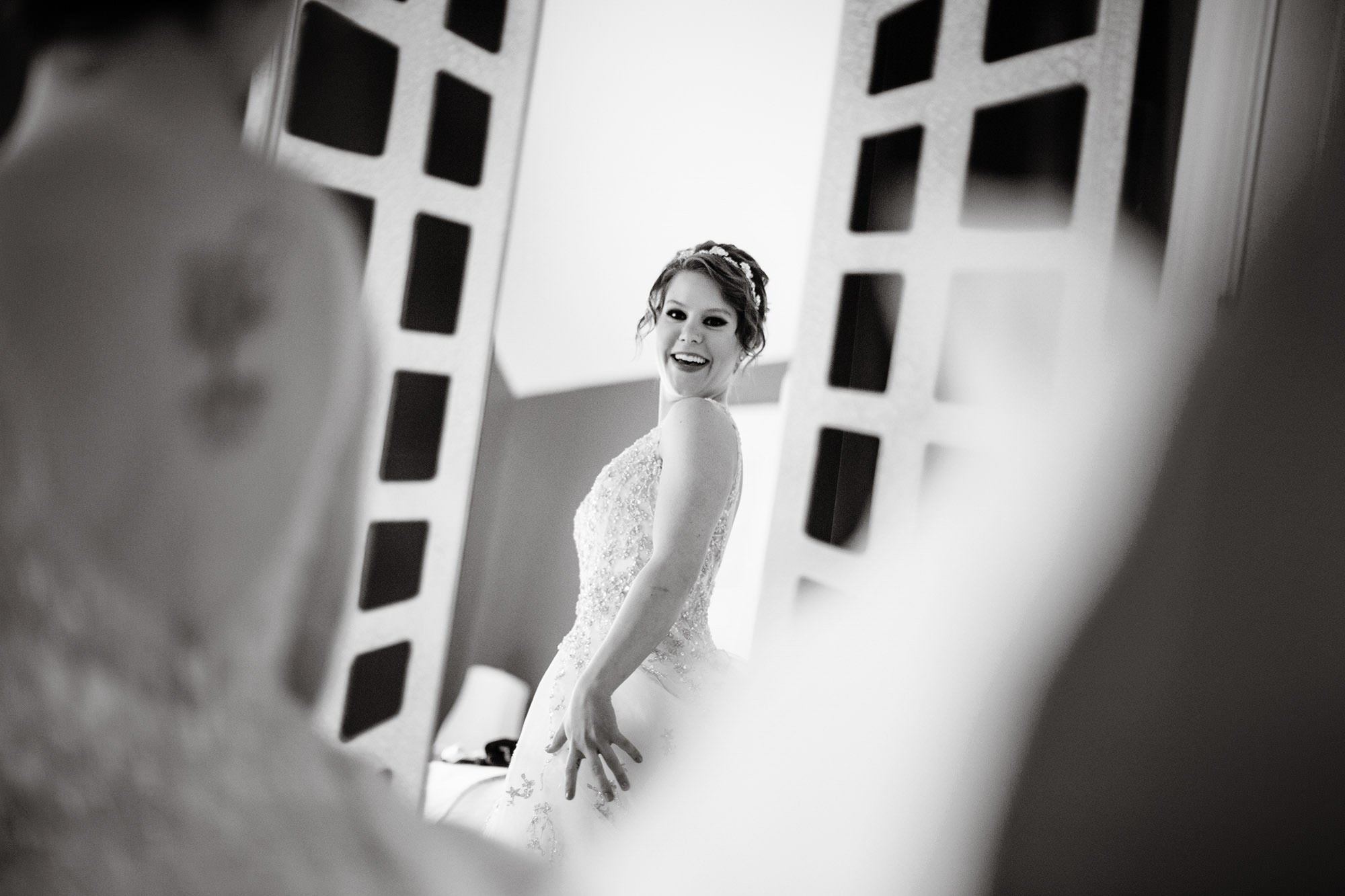 The bride shows off her dress prior to the ceremony at her Oaks Waterfront Inn Wedding.