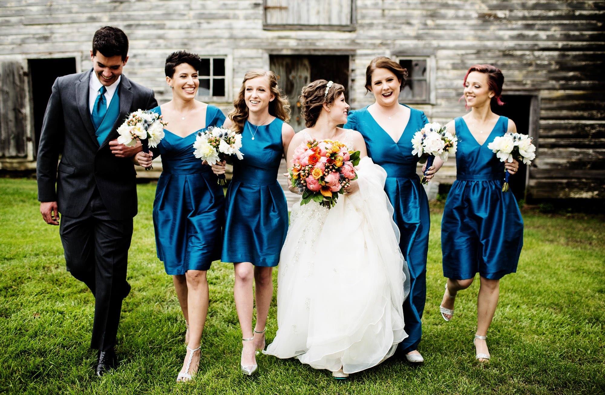 Bridal party portrait outside the barn on the venue grounds.