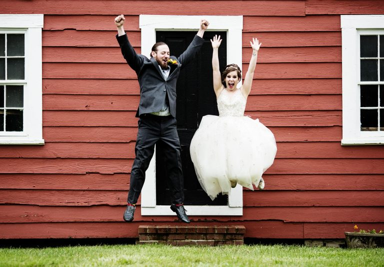 The bride and groom celebrate following their ceremony a their Oaks Waterfront Inn Wedding in Royal Oak, MD
