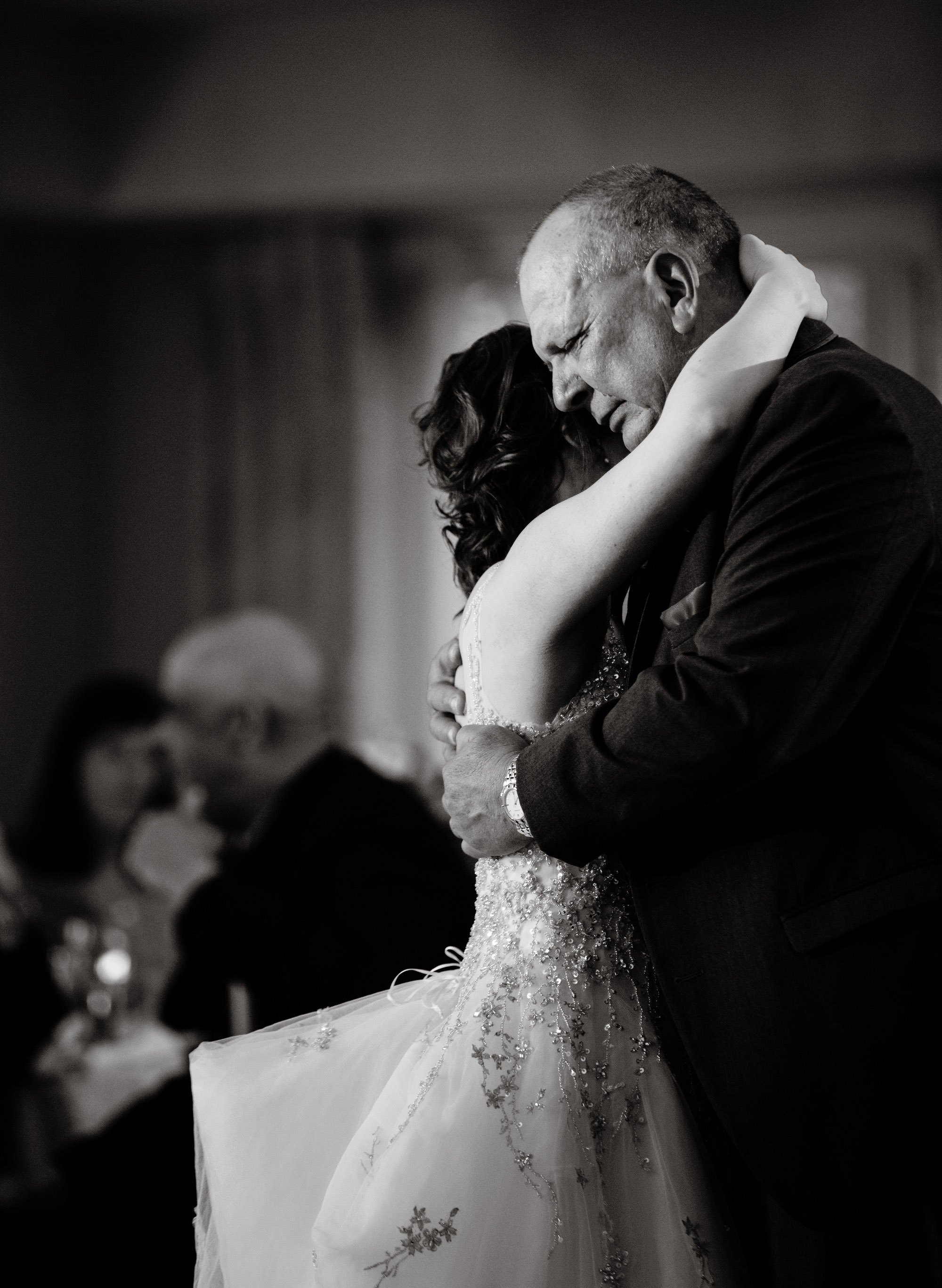 The bride dances with her father during her Oaks Waterfront Inn Wedding.