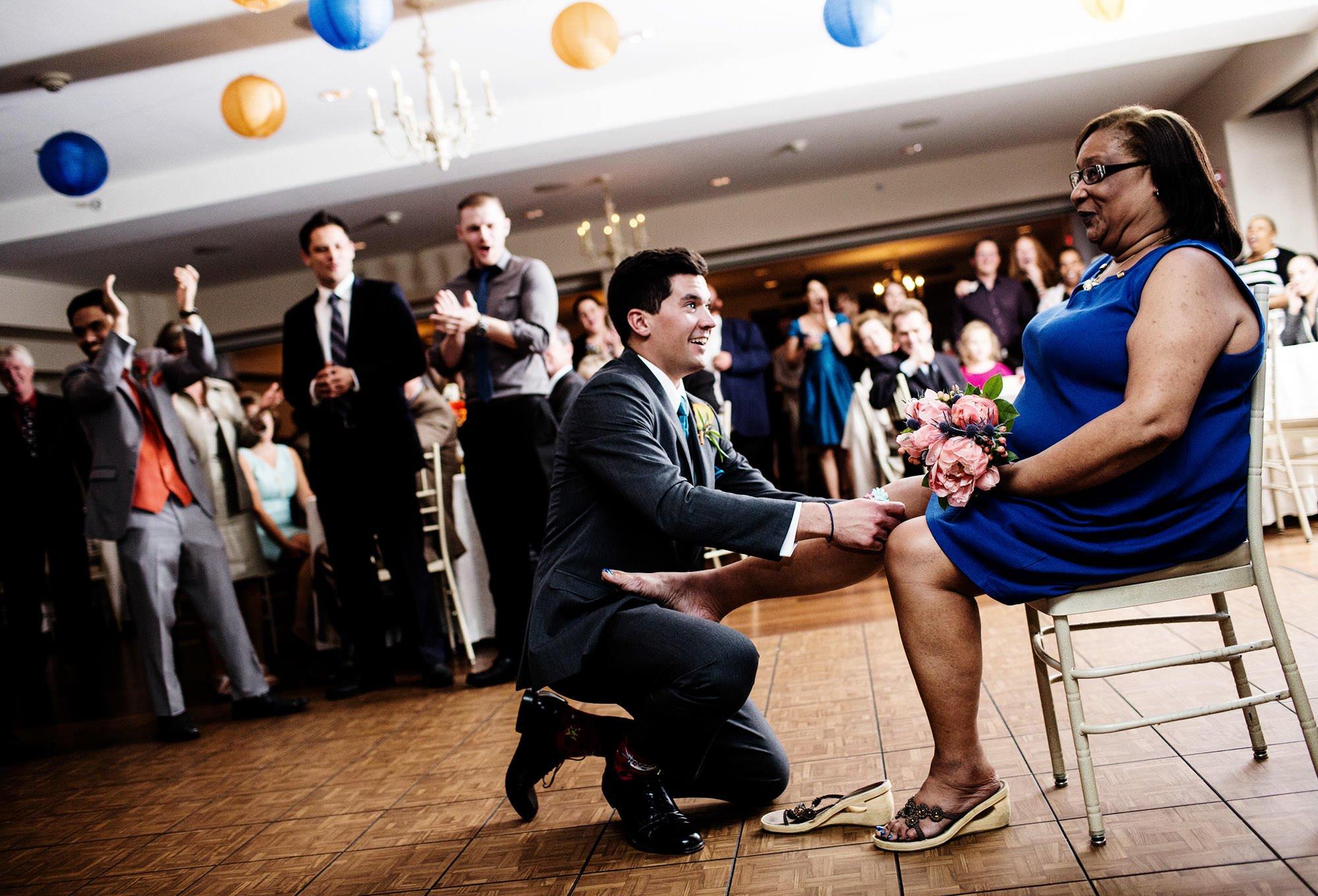 The Bouquet/Garter Toss during the wedding reception at Oaks Waterfront Inn.