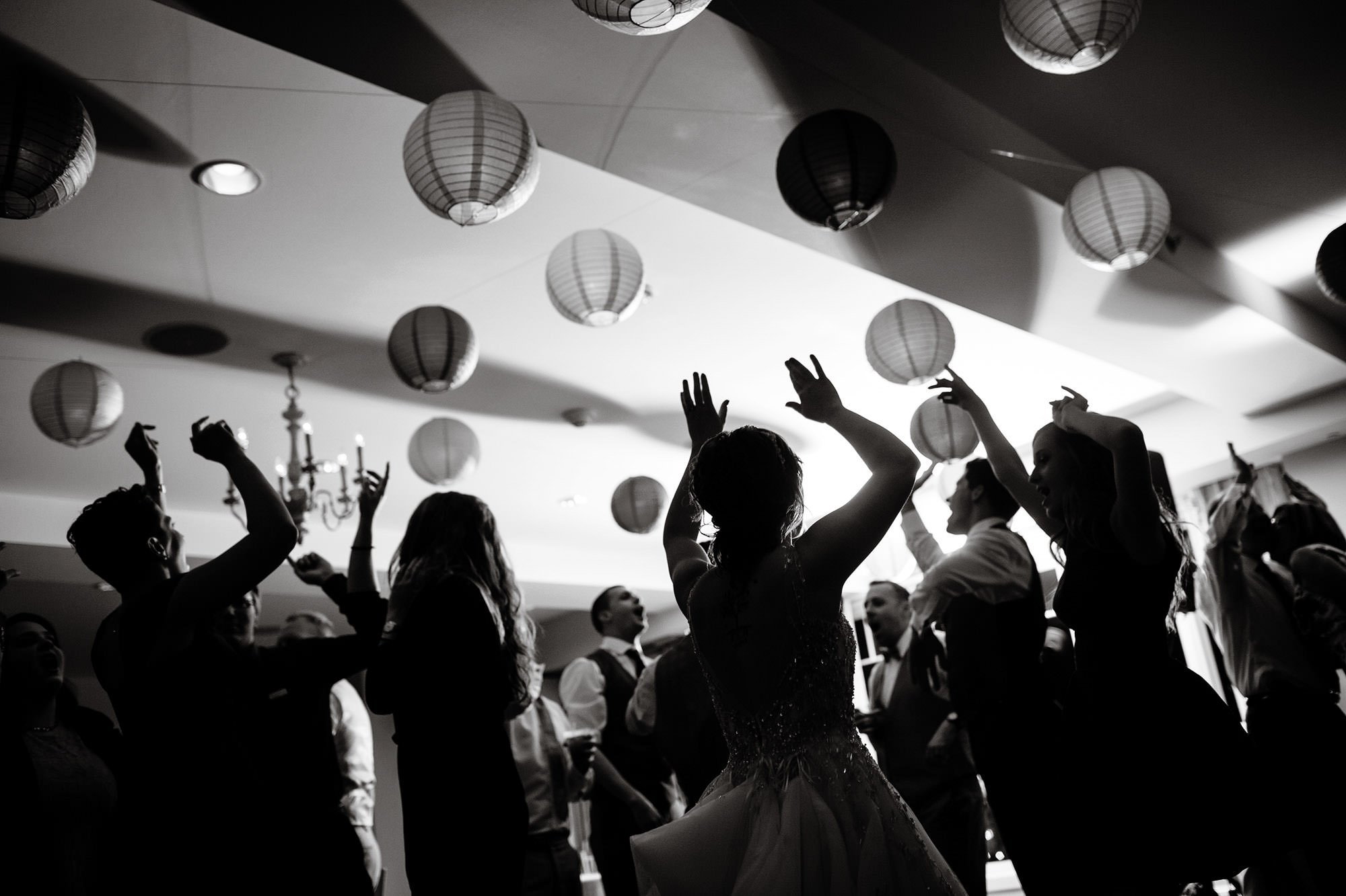 Guests dance the night away during this Oaks Waterfront Inn Wedding.