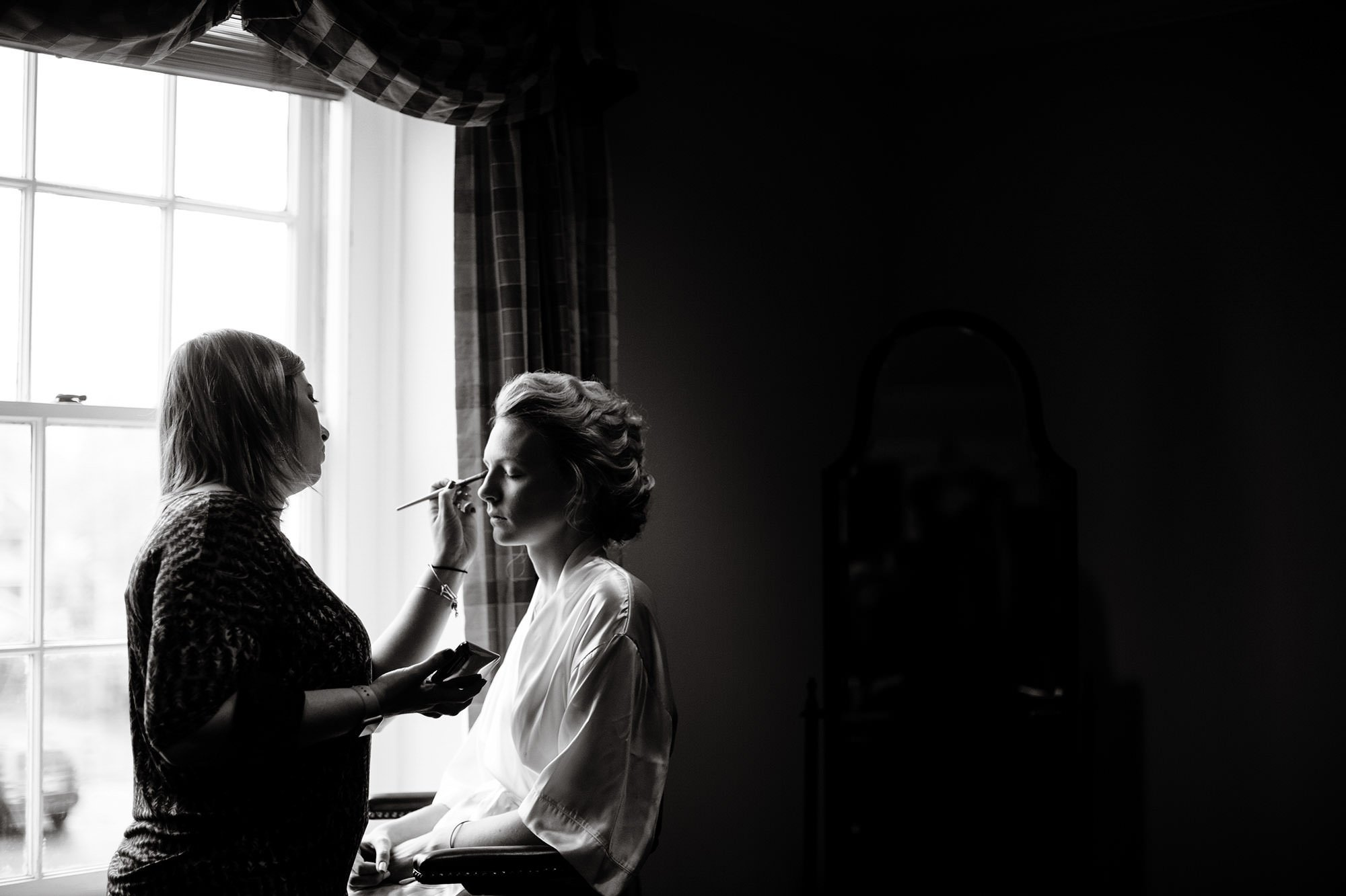 The bride gets ready prior to the ceremony at Tidewater Inn.
