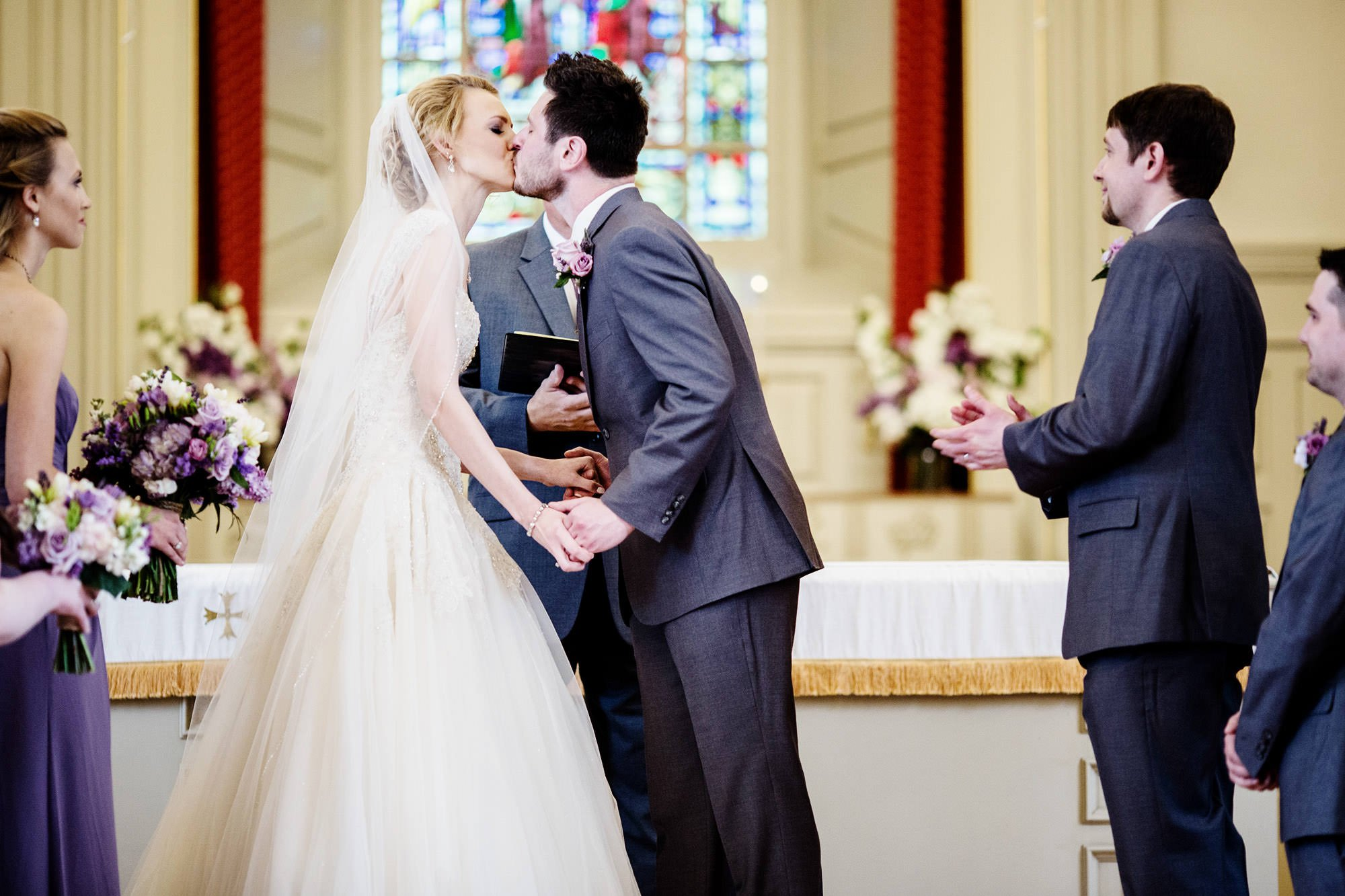 The bride and groom share their first kiss at St. Mark's United Methodist Church