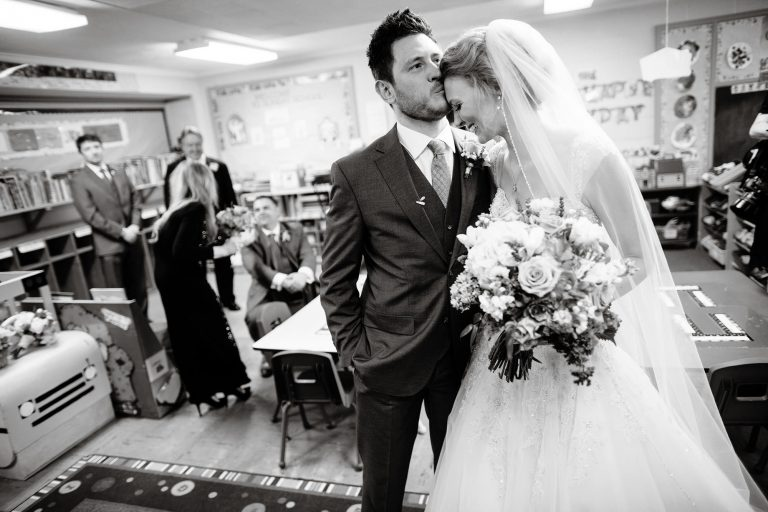 The bride and groom share a kiss following their ceremony during their Tidewater Inn Wedding in Easton, MD