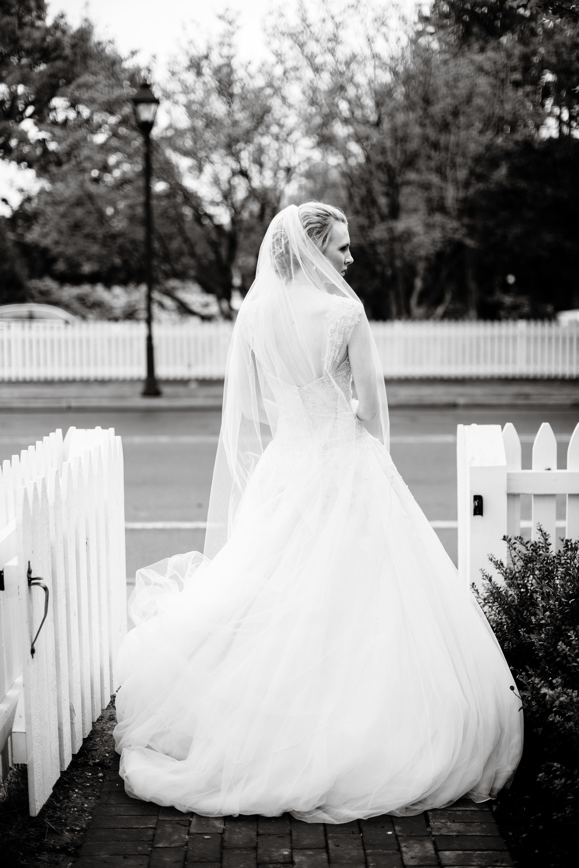 The bride waits for her groom following the ceremony in Easton, MD.