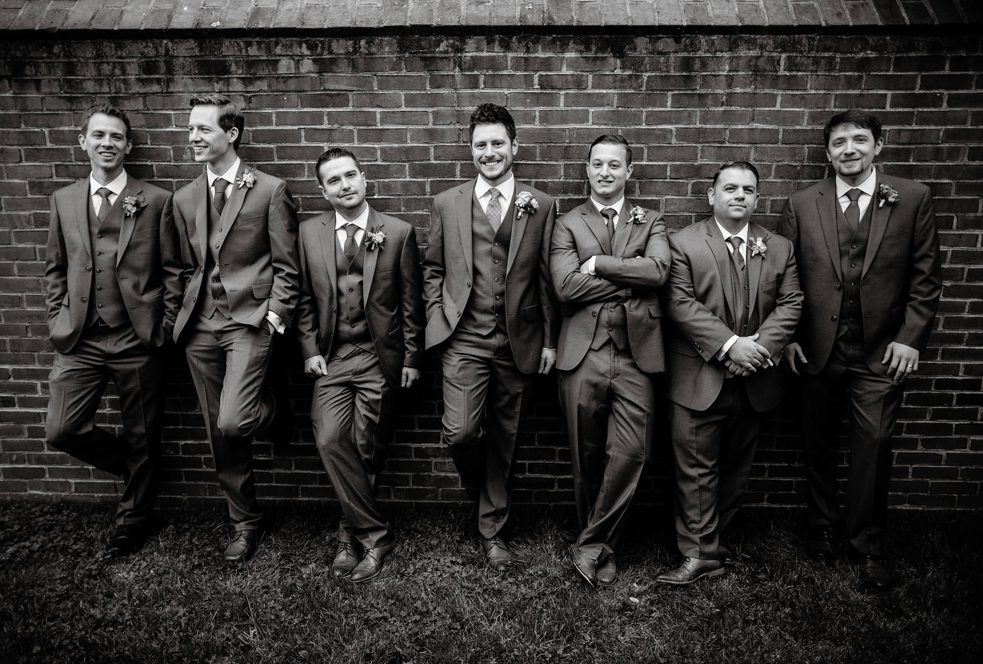 Groomsmen pose for portraits after the ceremony.