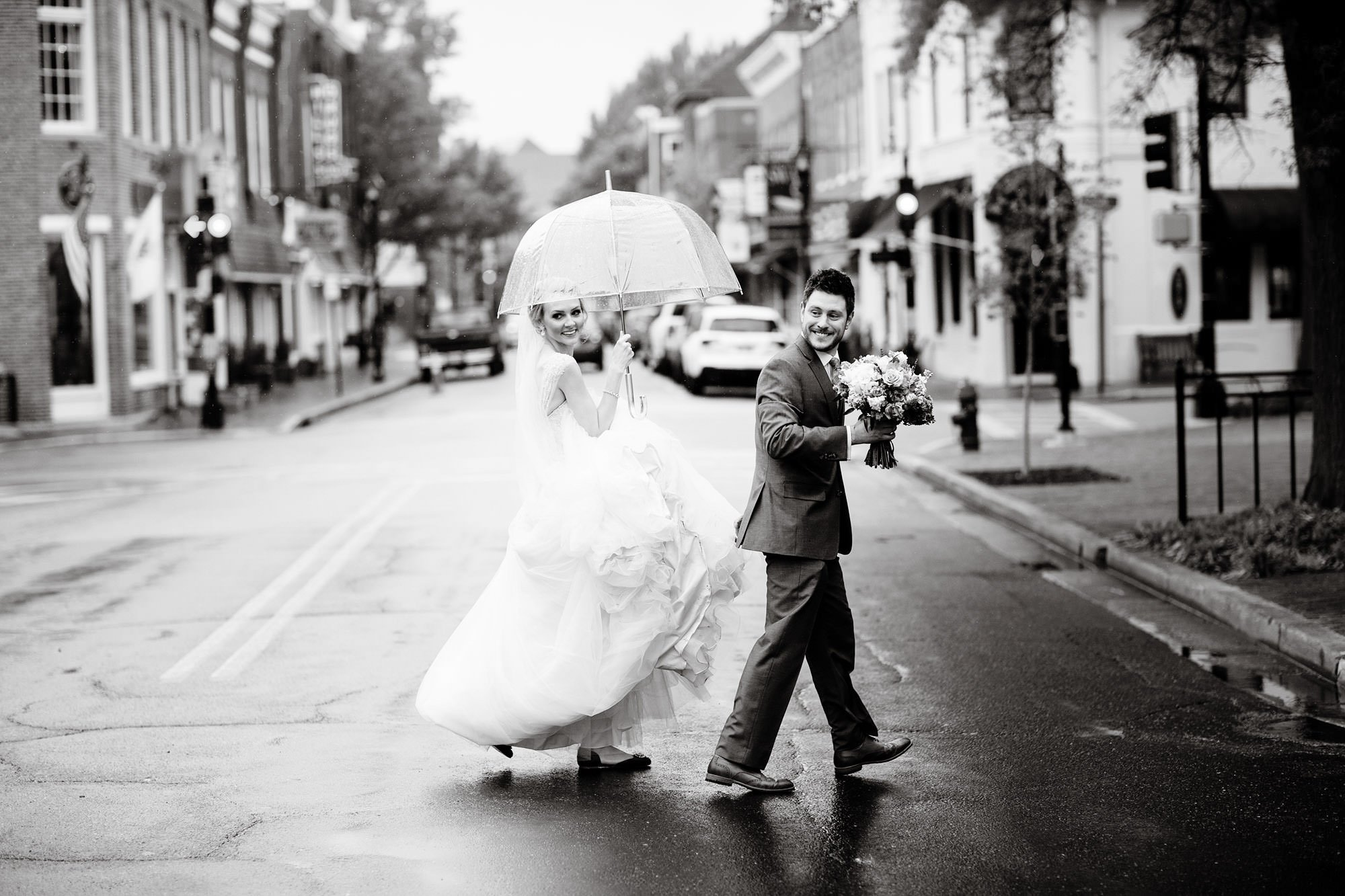 The bride and groom cross the street in Easton, MD before their wedding reception at Tidewater Inn.
