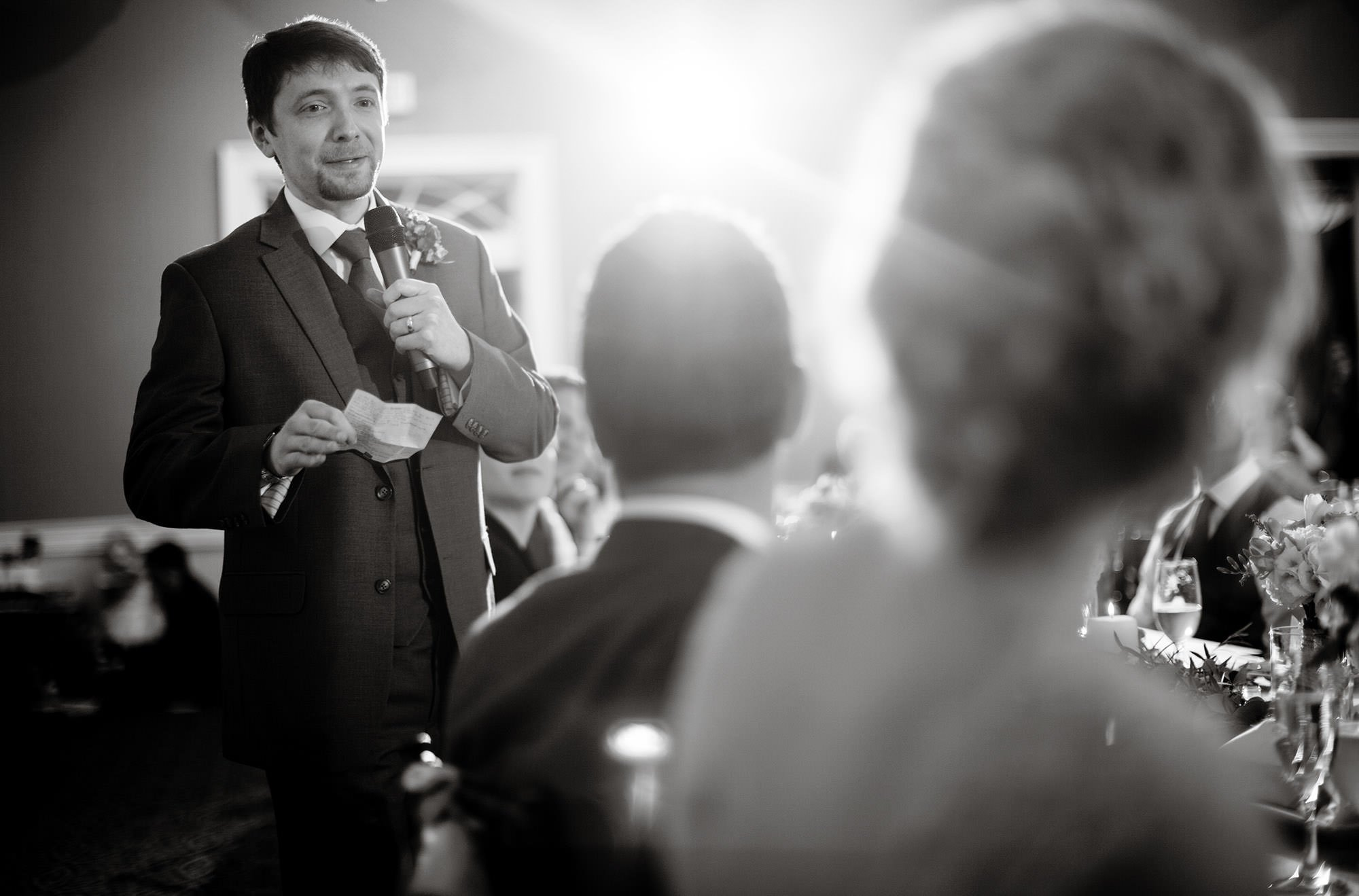 The best man gives a toast during the reception at Tidewater Inn.