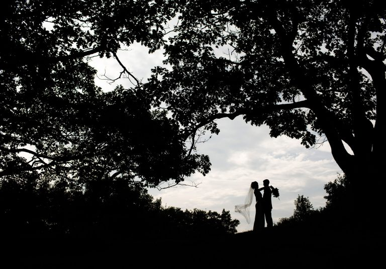 The bride and groom pose for a portrait during their Wachusett Mountain Wedding in Princeton, MA.