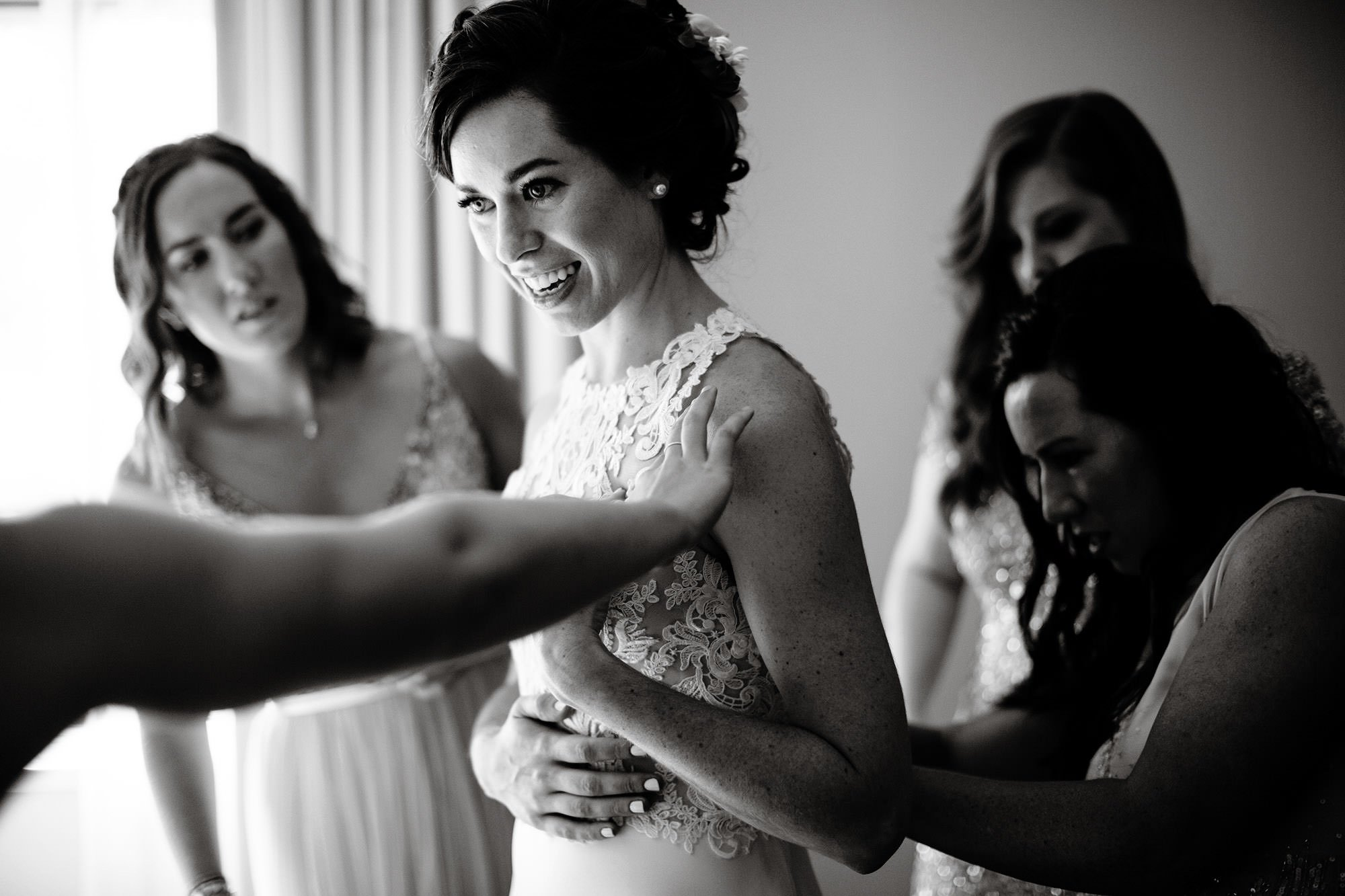The bride puts on her dress prior to the ceremony.