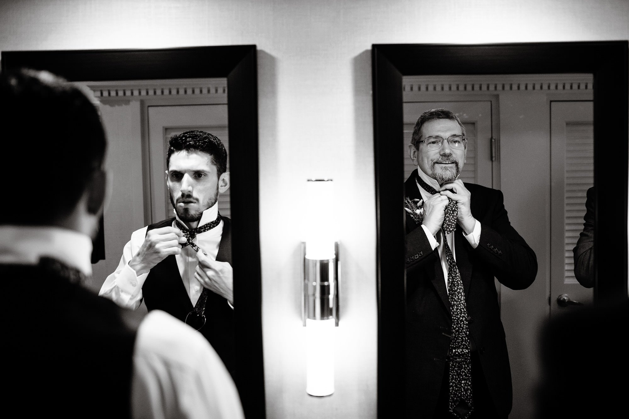 The groom gets ready with his dad before his Wachusett Mountain Wedding.