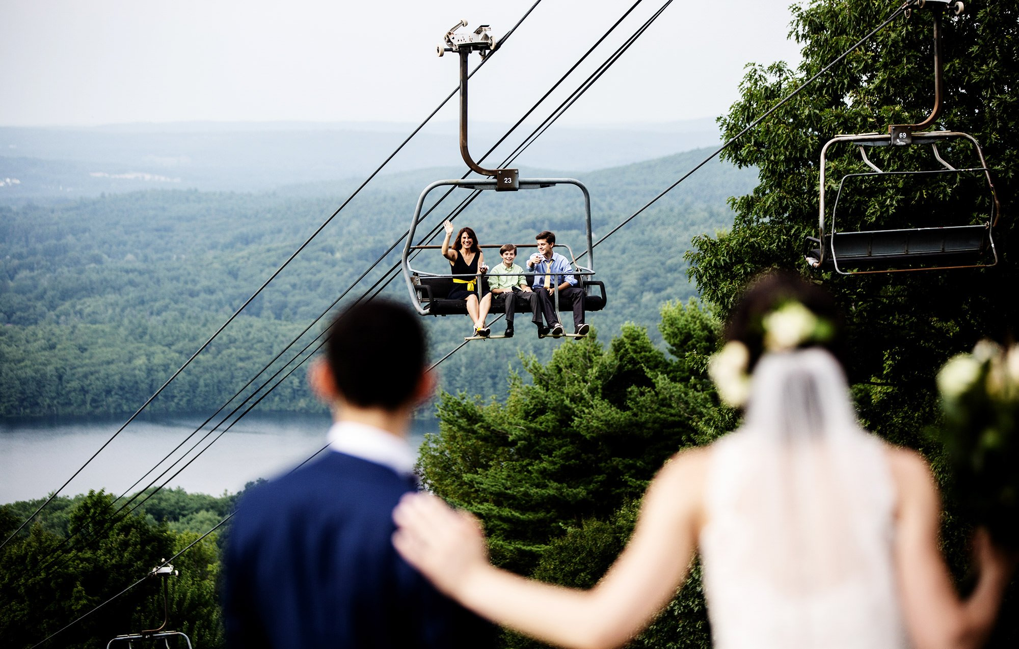 The Bride and Groom greet their guests on the ski lift during cocktail hour of their Wachusett Mountain Wedding.