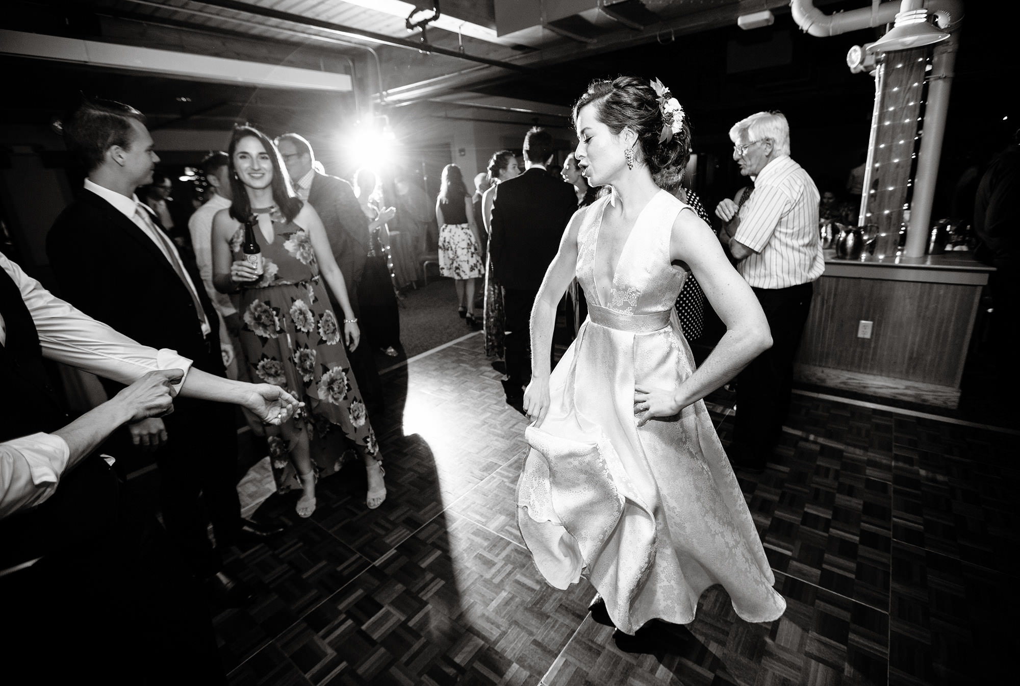 Guests dance during the reception at Wachusett Mountain..