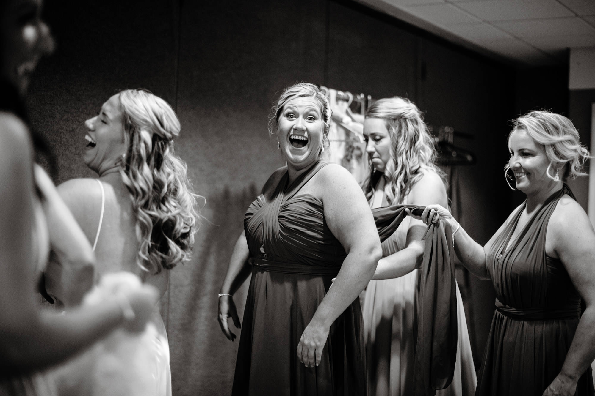 Bridesmaids put on their dresses prior to the ceremony at Wequassett Resort.