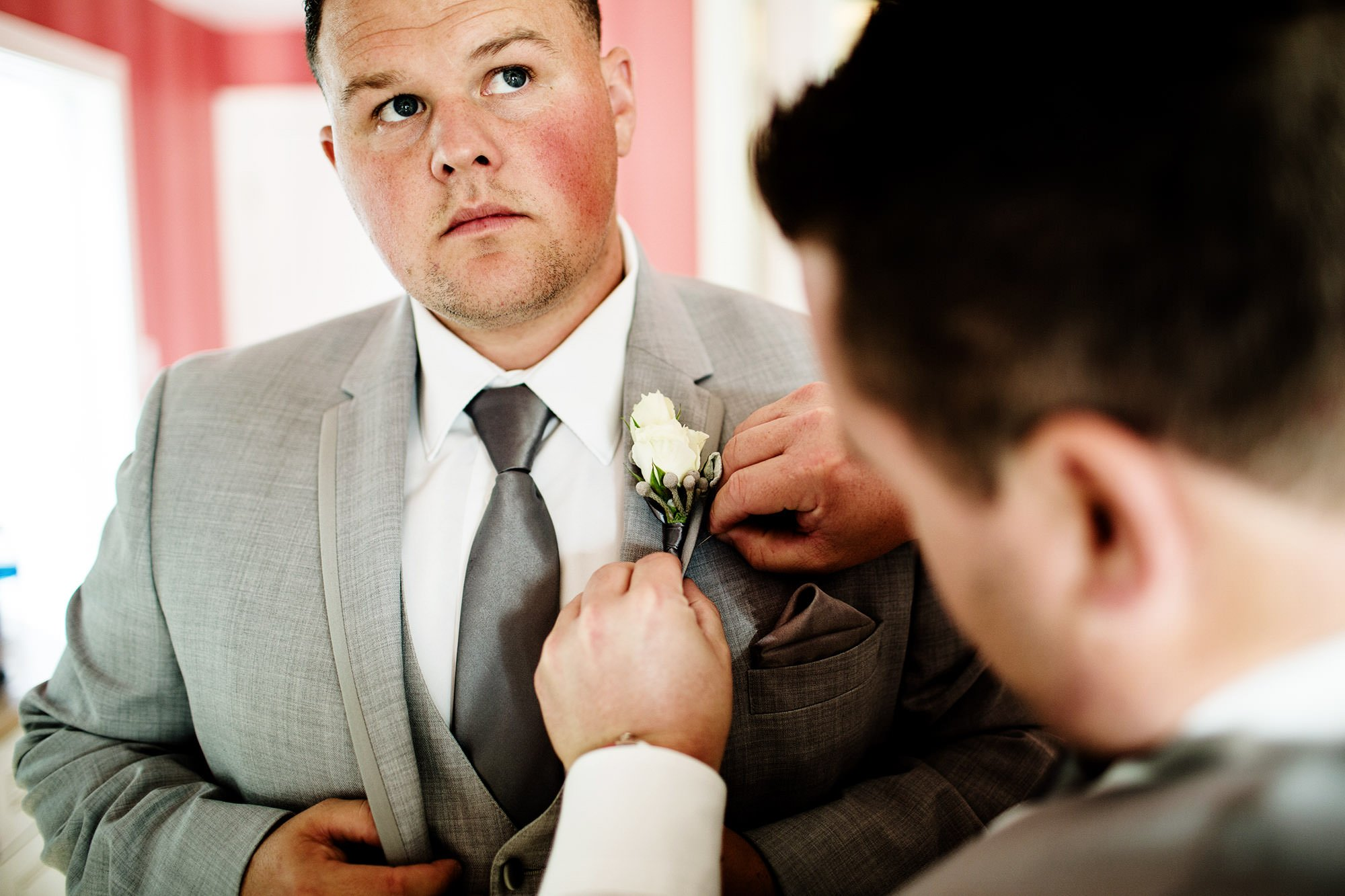 Groomsmen getting ready before the ceremony during this Wequassett Resort Wedding.