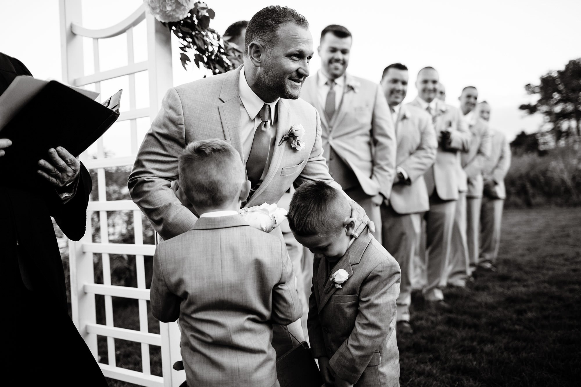 The groom greets his ring bearers during the wedding ceremony at Wequassett Resort.