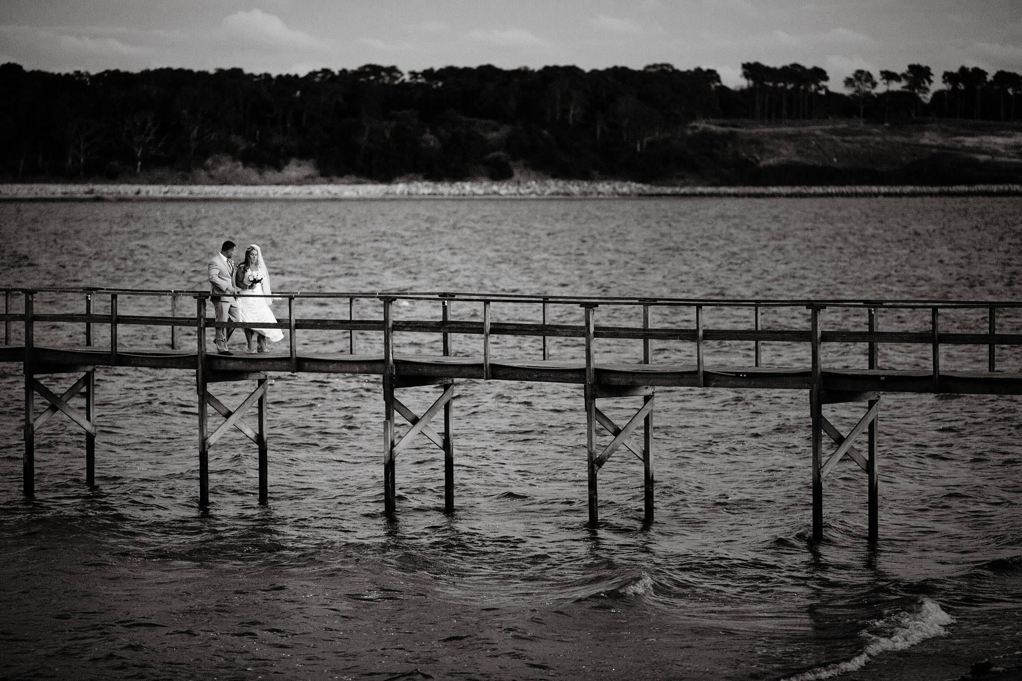 The bride and groom walk down the dock at their Wequassett Resort and Golf Club Wedding in Harwich, MA