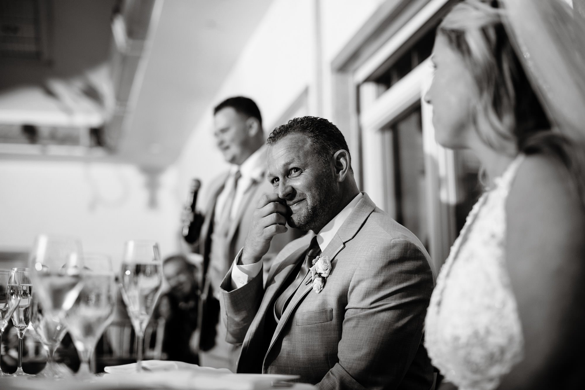 The groom listens to toasts during his Wequassett Resort wedding.