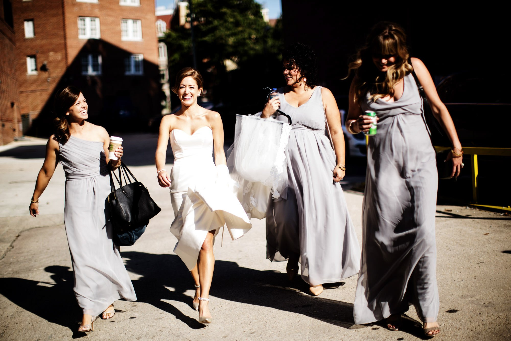 The bridal party walks to Anderson House.