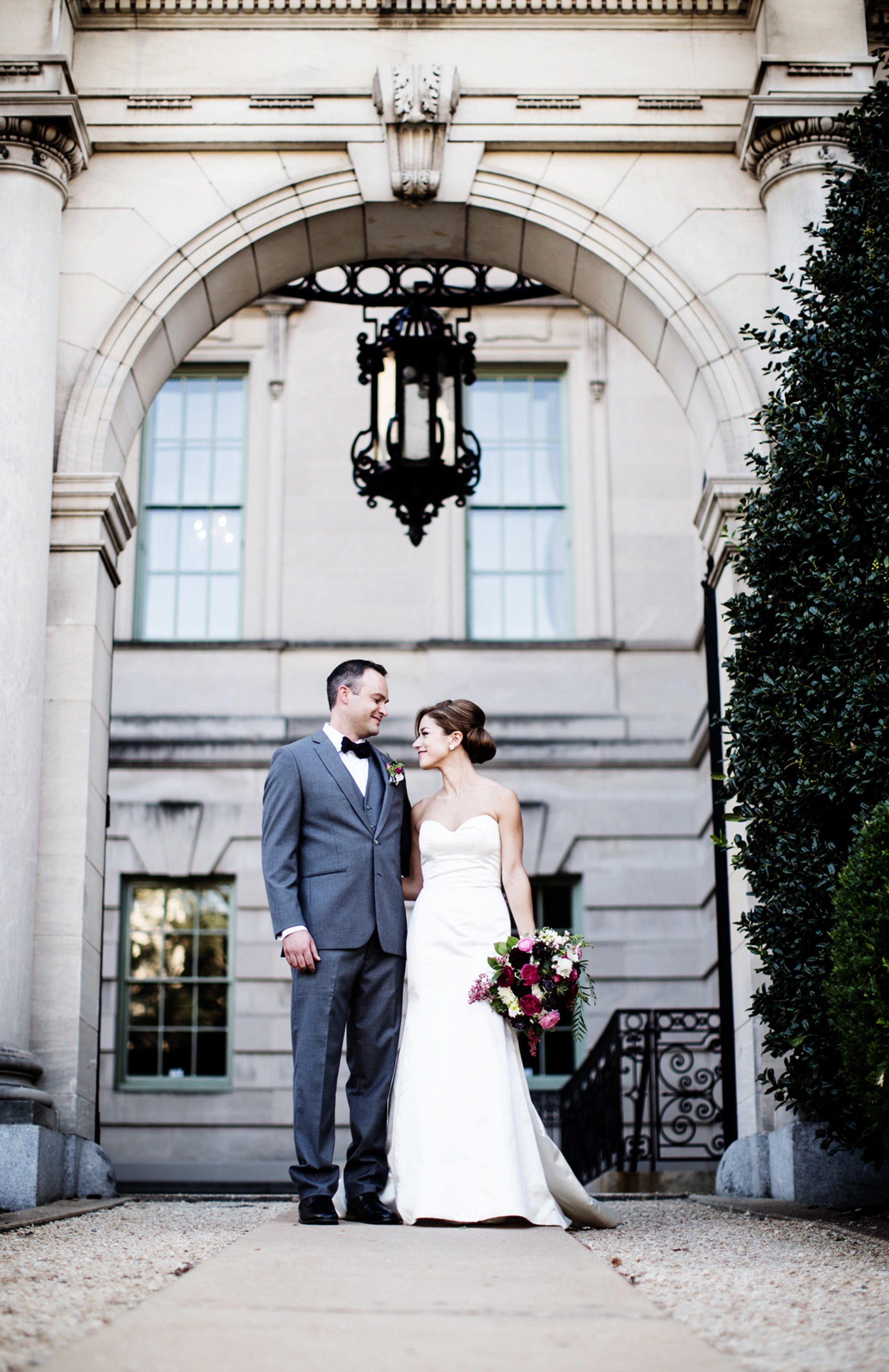 A portrait of the bride and groom at the entrance of Anderson House.