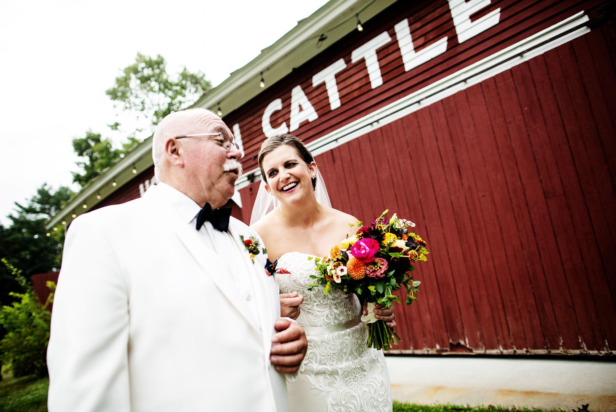 The bride smiles at her father before her Bishop Farm wedding.