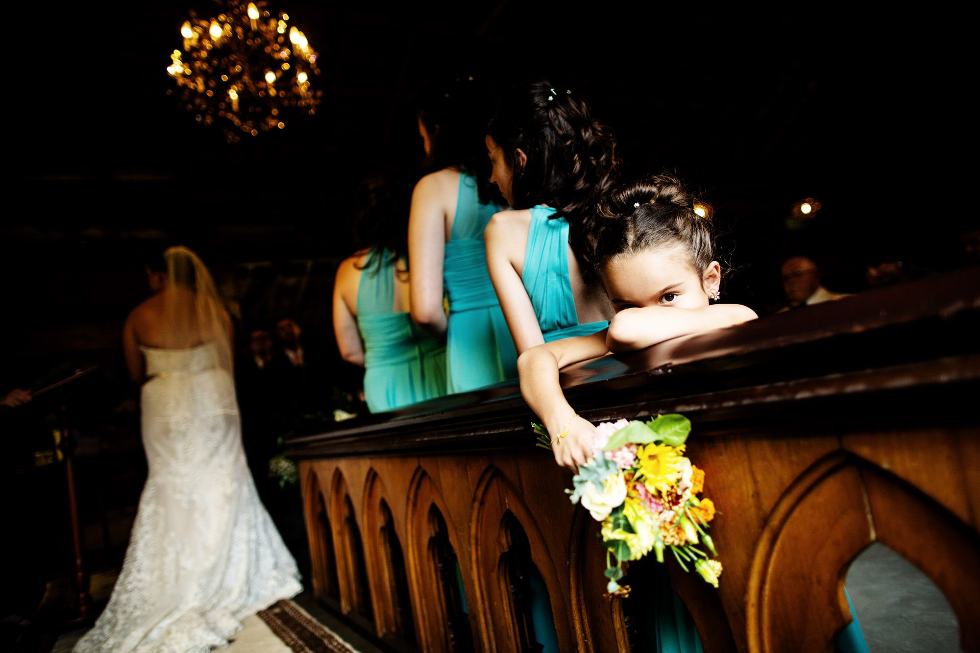 The flower girl waits for the ceremony to conclude.
